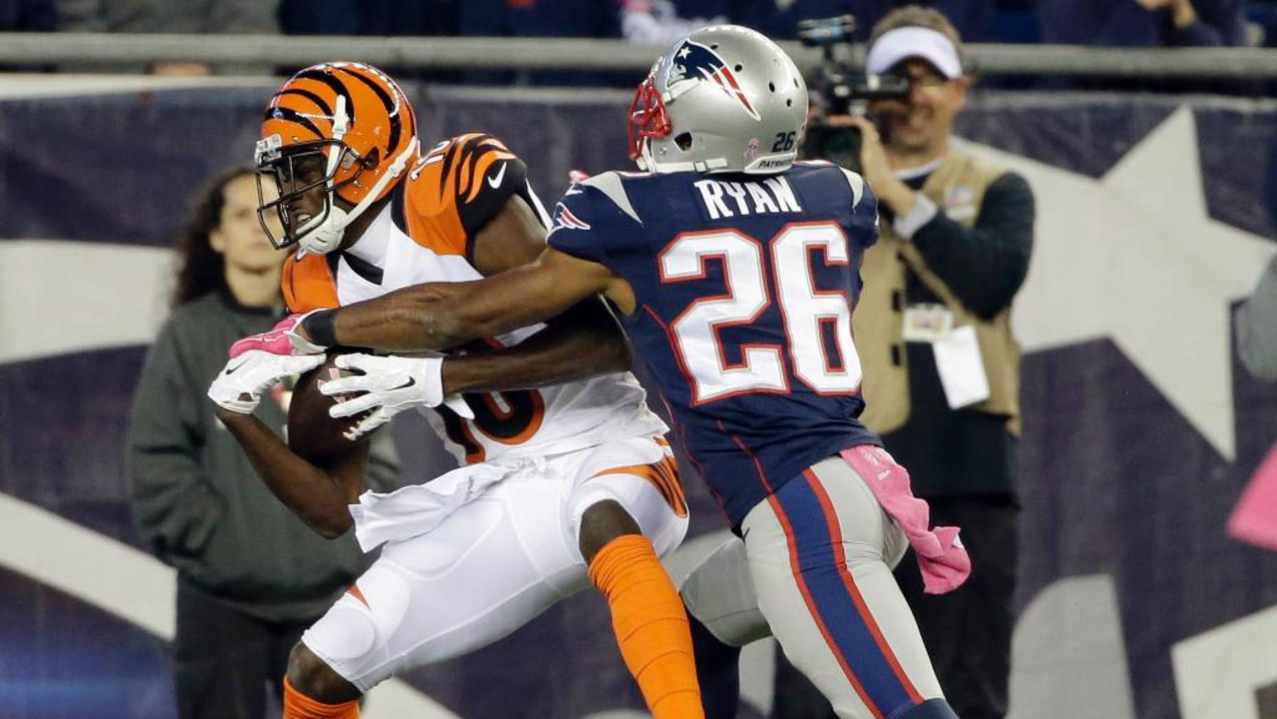 Cincinnati Bengals wide receiver A.J. Green (18) catches a touchdown pass in front of New England Patriots cornerback Logan Ryan (26) in the second half of an NFL football game Sunday, Oct. 5, 2014, in Foxborough, Mass. (AP Photo/Steven Senne)