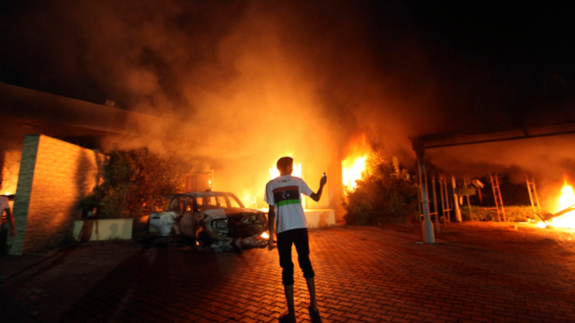 Sept. 11, 2012: The U.S. Consulate in Benghazi is seen in flames.