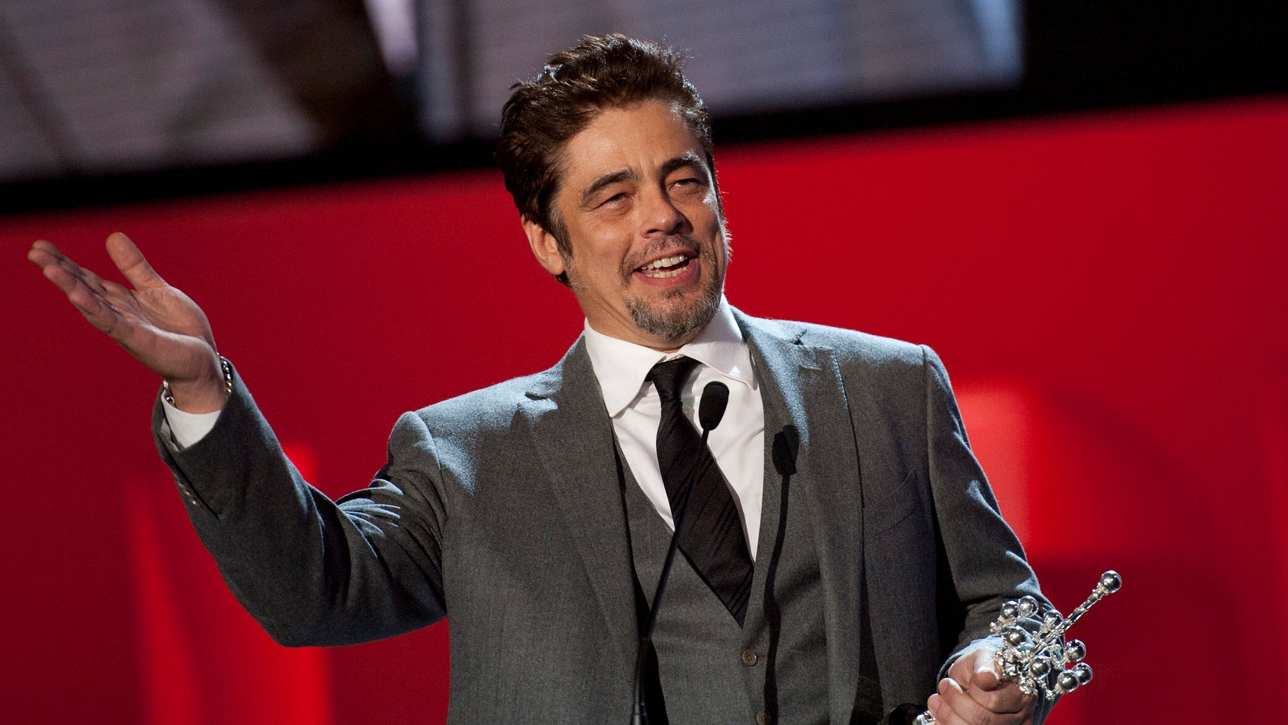 Puerto Rican born actor Benicio del Toro shows his trophy after receiving the Donostia Award for his contribution for the cinema, at the 62nd San Sebastian Film Festival, in San Sebastian, northern Spain, Friday, Sept. 26, 2014. The festival is one of the most prestigious and internationally recognised in Spain. (AP Photo/Alvaro Barrientos)