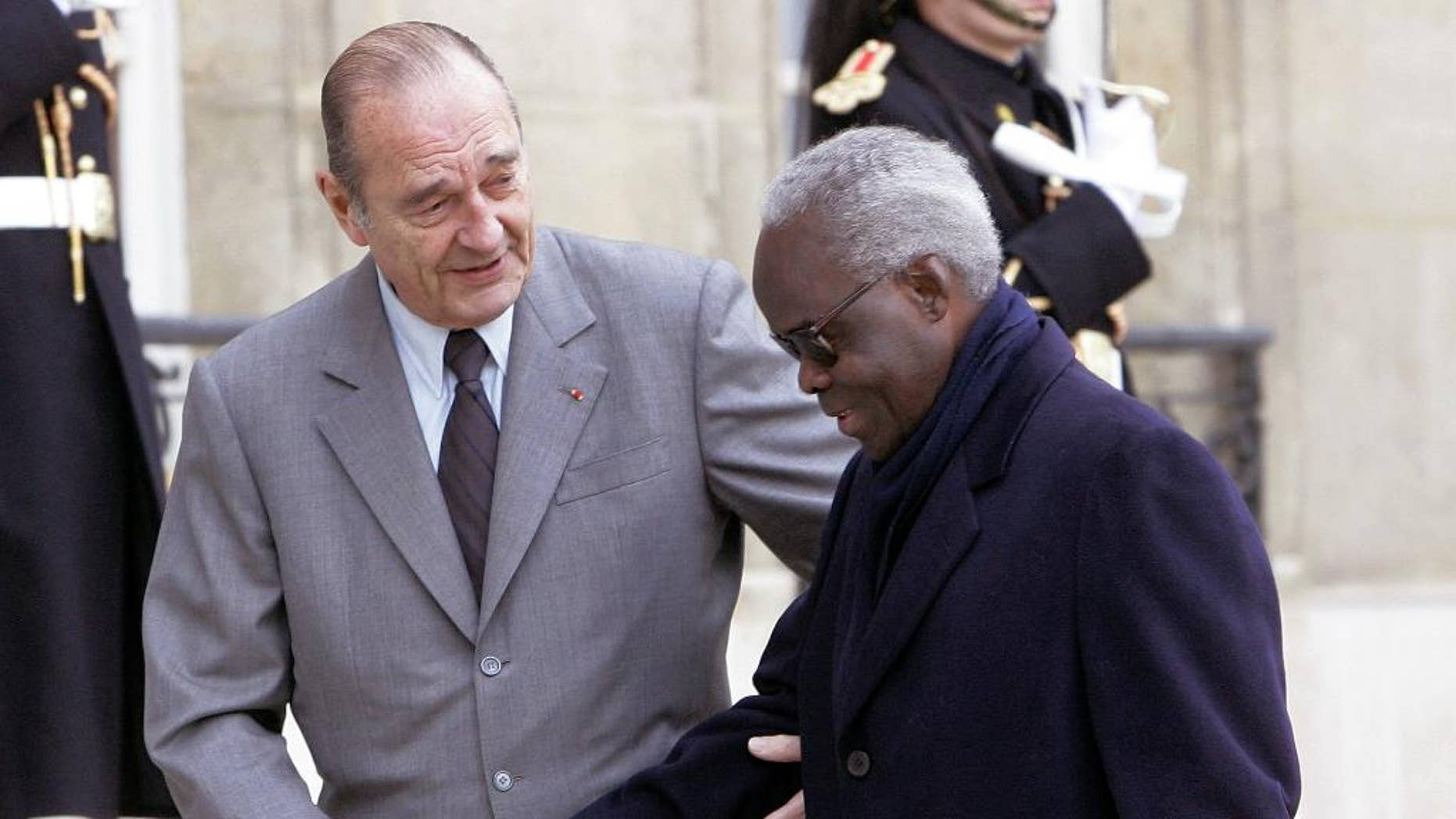 FILE-In this file photo taken on Friday, Nov. 25, 2005, French President Jacques Chirac, left, welcomes President of Benin,  Mathieu Kerekou, upon his arrival at the Elysee Palace in Paris.  Benin's president says that former leader Mathieu Kerekou has died.  President Boni Yayi on Wednesday, Oct. 14, 2015, said Kerekou was a great man, and called for seven days of national mourning. He presented his condolences to the nation.(AP Photo/Michel Euler, FILE)