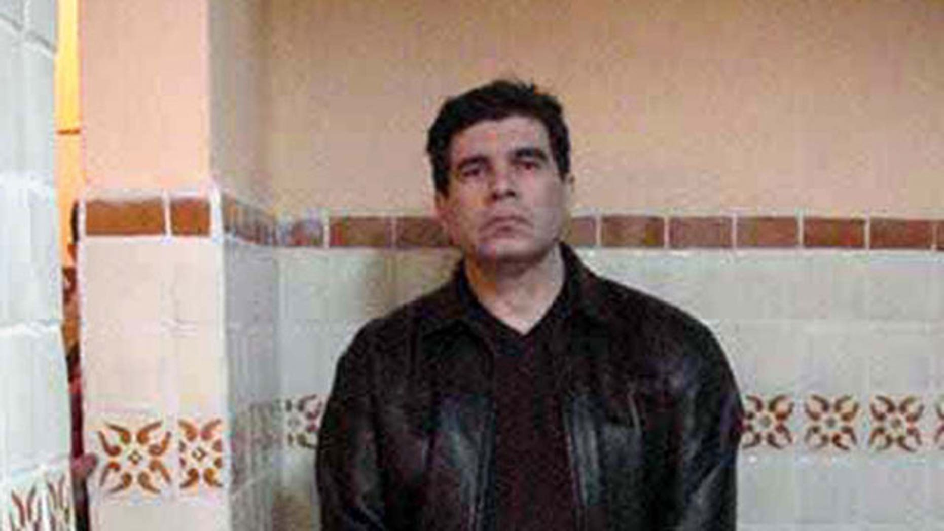 In this March 9, 2002 file photo released by Mexico's Attorney General's Office, Benjamin Arellano Felix stands in his home the day of his arrest in Puebla, Mexico.