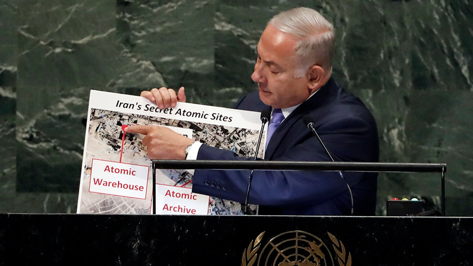 Israel's Prime Minister Benjamin Netanyahu shows an atomic warehouse in Tehran during his address at the 73rd session of the United Nations General Assembly on Thursday.