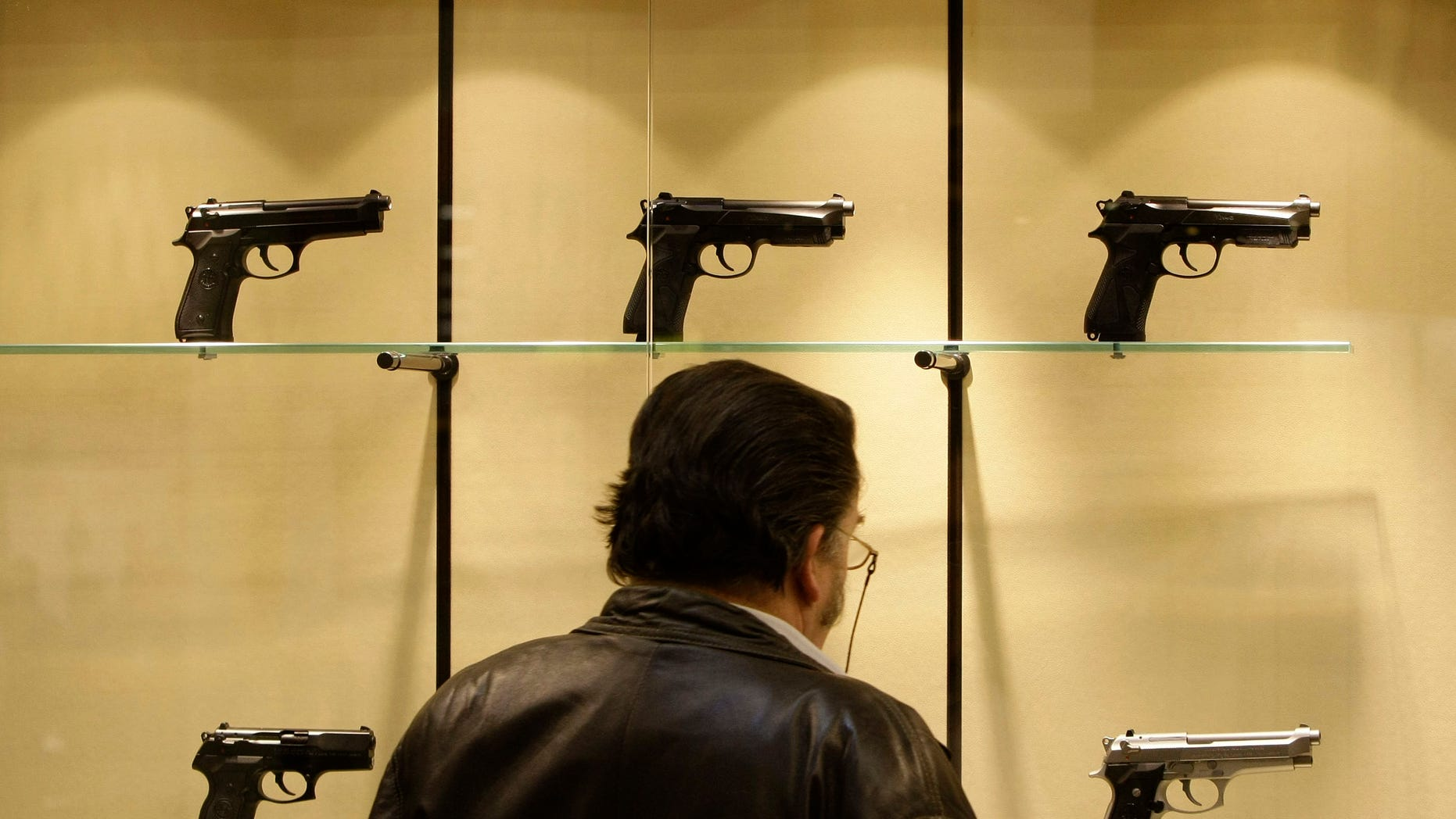 FILE: March 2009: A man looks at Beretta guns during the International Guns Exhibition and Outdoor Classics in Nuremberg, Germany.