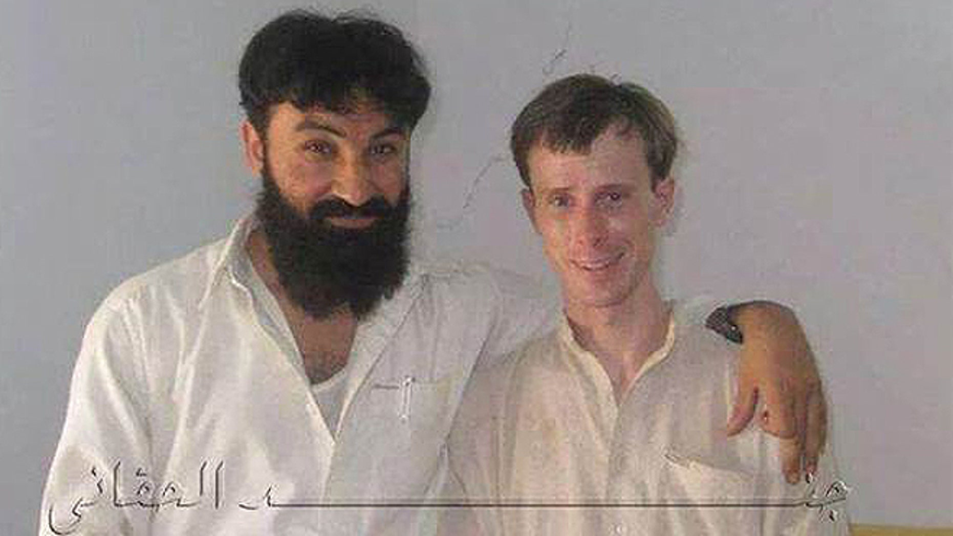 In this undated photo provided my MEMRI, Sgt. Bowe Bergdahl is seen posing with a senior member of the Haqqani network in Afghanistan during his five years in captivity.