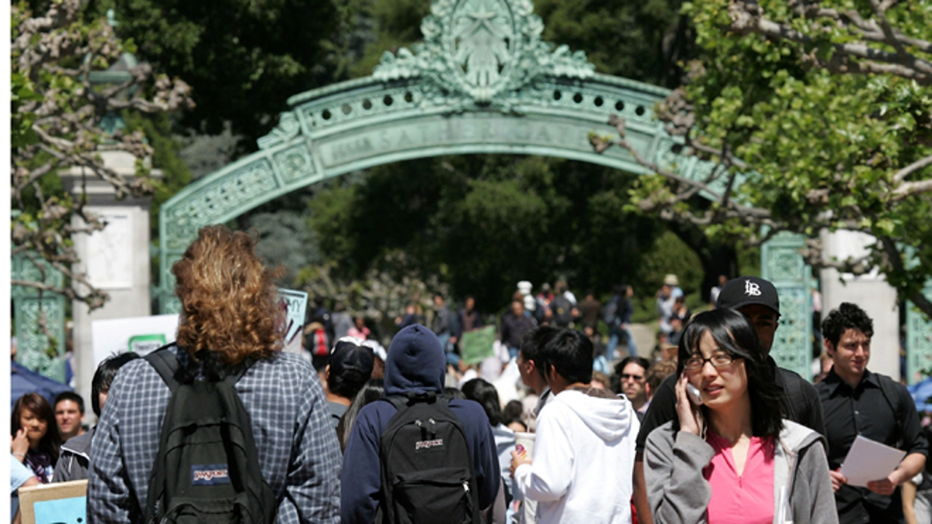 BERKELEY, CA - APRIL 17:  UC Berkeley students walk through Sather Gate on the UC Berkeley campus April 17, 2007 in Berkeley, California.  Robert Dynes, President of the University of California, said the University of California campuses across the state will reevaluate security and safety policies in the wake of the shooting massacre at Virginia Tech that left 33 people dead, including the gunman, 23 year-old student Cho Seung-Hui.  (Photo by Justin Sullivan/Getty Images)