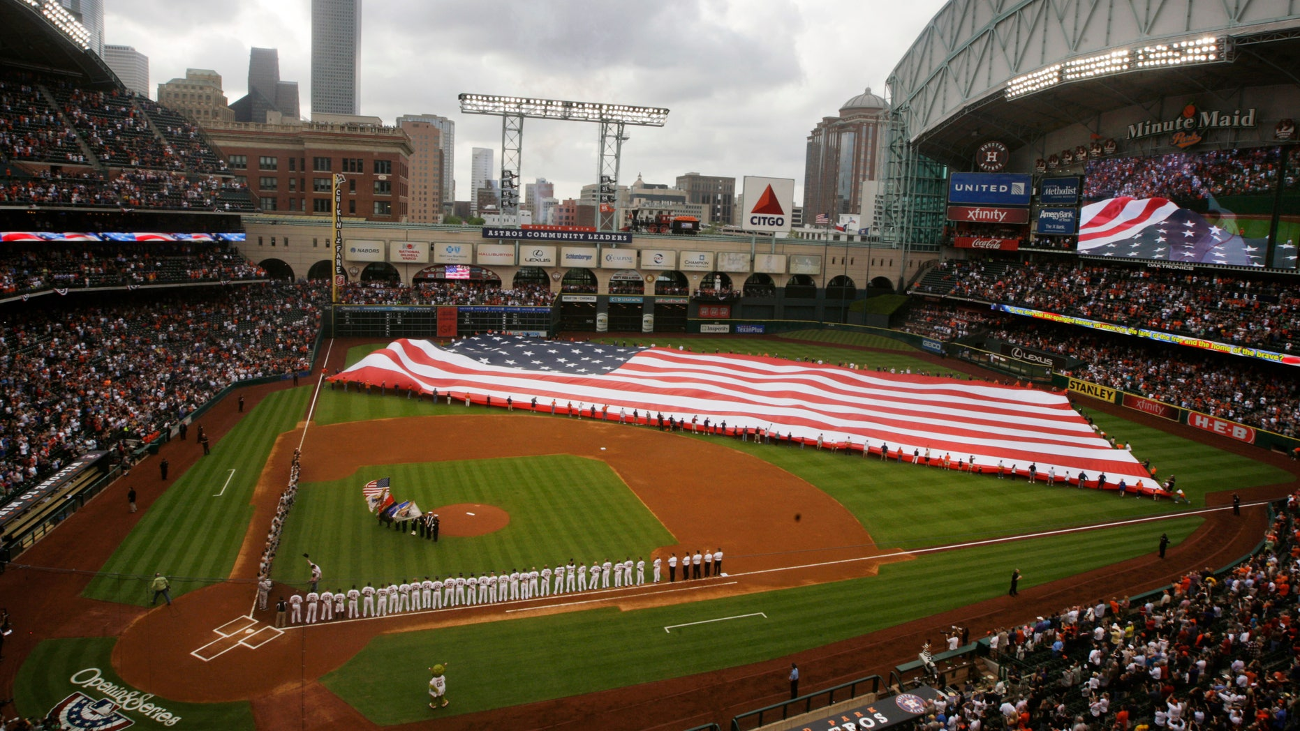 A U.S. flag is placed in the outfield for the national anthem before a baseball game between the Houston Astros and the New York Yankees, April 1, 2014, in Houston.