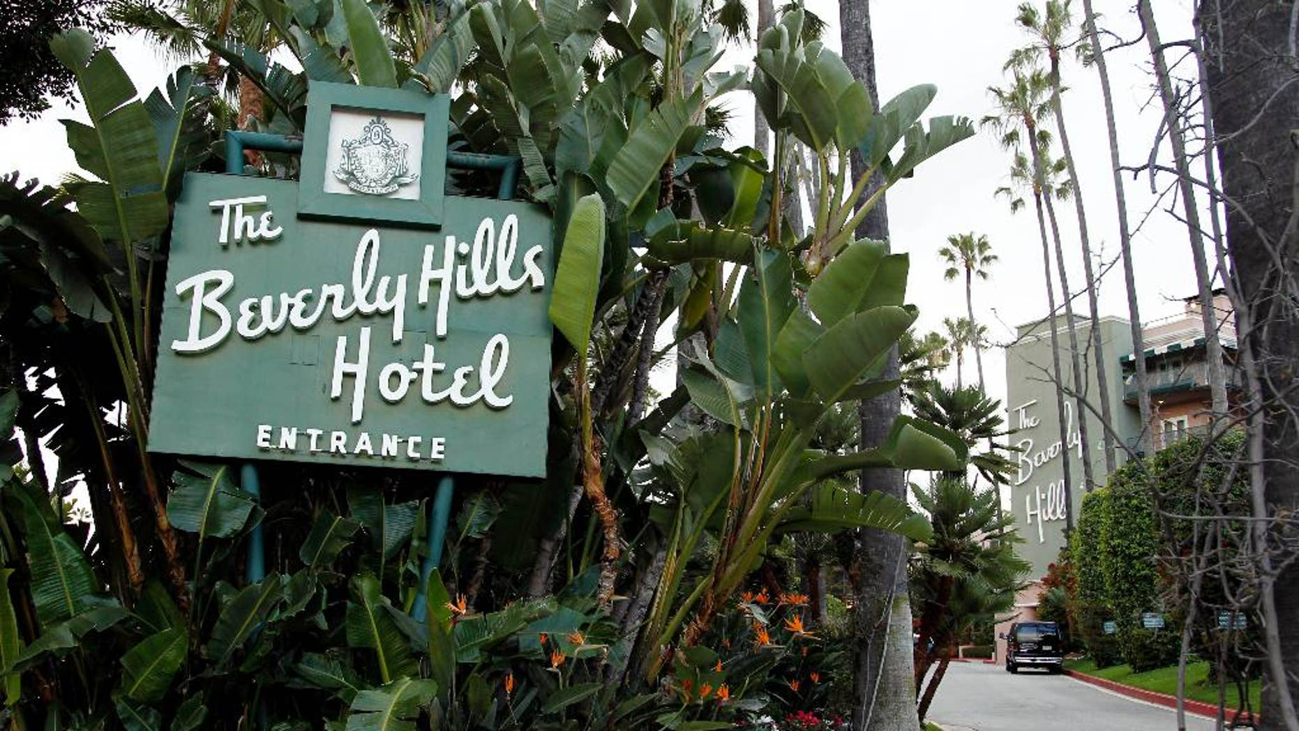 FILE - In this April 25, 2012 file photo, the entrance to the Beverly Hills Hotel is seen in Beverly Hills, Calif.  Hollywood is responding to harsh new laws in Brunei by boycotting the Beverly Hills Hotel. The Motion Picture & Television Fund joined a growing list of organizations and individuals Monday, May 5, 2014, refusing to do business with hotels owned by the Sultan or government of Brunei to protest the country's new penal code that calls for punishing adultery, abortions and same-sex relationships with flogging and stoning.  (AP Photo/Matt Sayles, File)