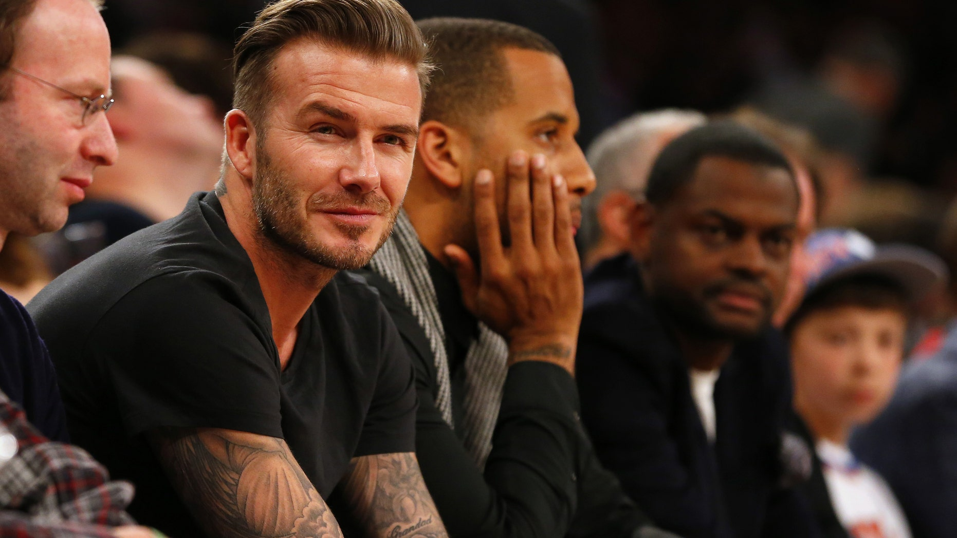 NEW YORK, NY - FEBRUARY 1: Former soccer player David Beckham watches the action during a game between the Miami Heat and the New York Knicks at Madison Square Garden on February. 1, 2014 in New York City. The Heat defeated the Knicks 106-91. NOTE TO USER: User expressly acknowledges and agrees that, by downloading and/or using this Photograph, user is consenting to the terms and conditions of the Getty Images License Agreement. (Photo by Rich Schultz /Getty Images)