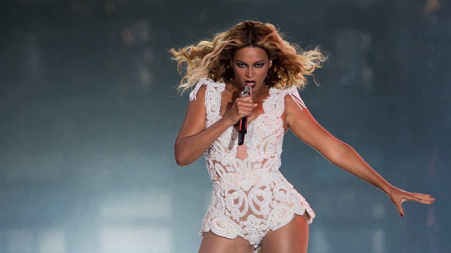 Beyoncé performs in the Rock in Rio Festival on September 13, 2013 in Rio de Janeiro, Brazil.