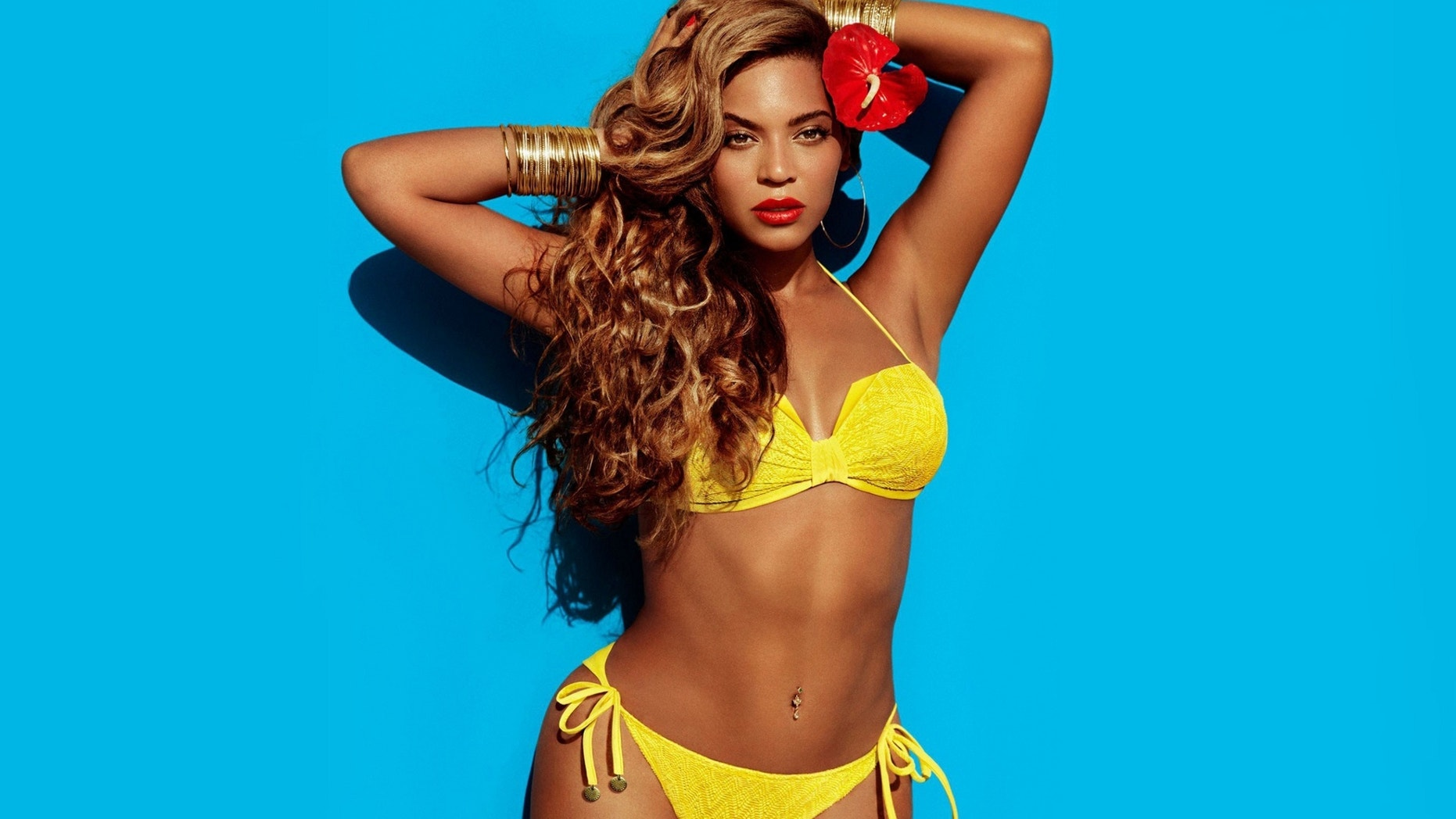 Beyonce poses in an ad for H&M.