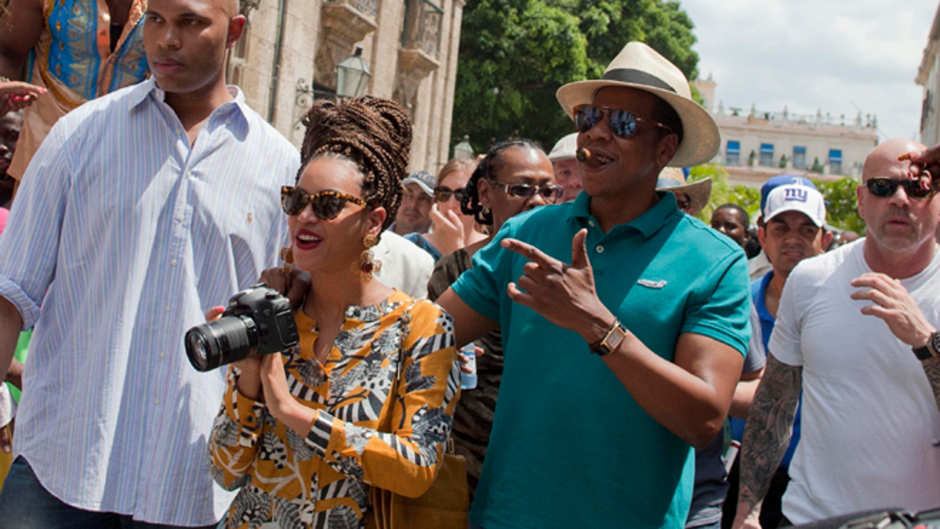 April 4, 2013: Singer Beyonce and her husband, rapper Jay-Z, are surrounded by body guards as they tour Old Havana, Cuba.