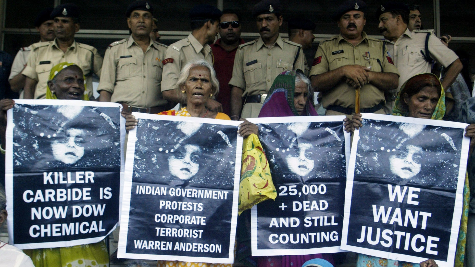June 7: Victims of Bhopal gas tragedy hold posters during a demonstration outside a court in the central Indian city of Bhopal. An Indian court on Monday sentenced seven people to two years each in prison for negligence in failing to prevent one of the world's worst industrial accidents that killed thousands of people in 1984.