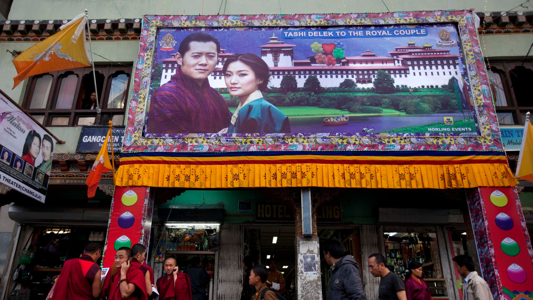 A large banner of King Jigme Khesar Namgyal Wangchuck and future Queen Jetsun Pema is seen on a storefront in the capital of Thimphu, Bhutan, Wednesday, Oct. 12, 2011. The 31 year-old reformist monarch of the small Himalayan Kingdom will wed his commoner bride in a series ceremonies set for Thursday.