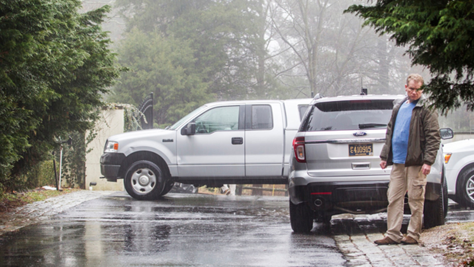 Jan. 18, 2015: A security official stands at the end of the driveway leading to Vice President Joe Biden's home in Greenville, Del. Multiple gunshots were fired from a vehicle near Biden's Delaware home Saturday night, the U.S. Secret Service said Sunday. (AP Photo/The News Journal, Kyle Grantham)