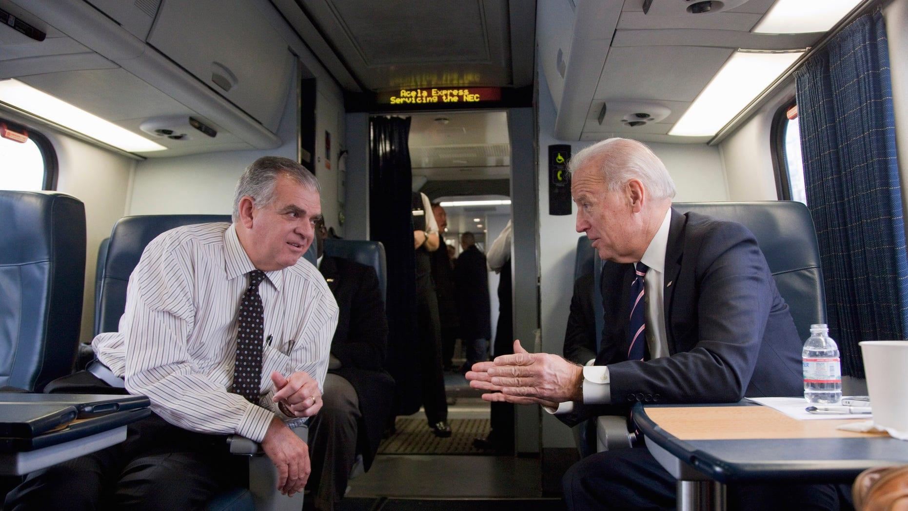 Feb. 8: Joe Biden, talks with Transportation Secretary Ray LaHood on a train heading to Philadelphia.
