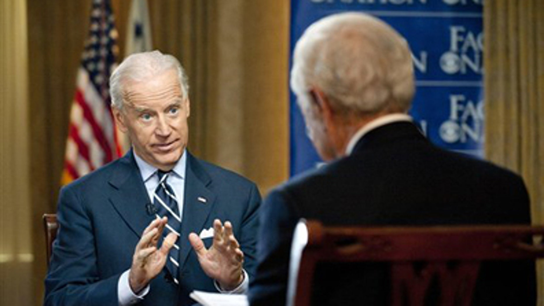 """March 29, 2012: In this photo provided by CBS News, Vice President Joseph Biden responds to a question by Bob Schieffer during a pre-taped interview for the CBS show """"Face the Nation"""" in Milwaukee."""