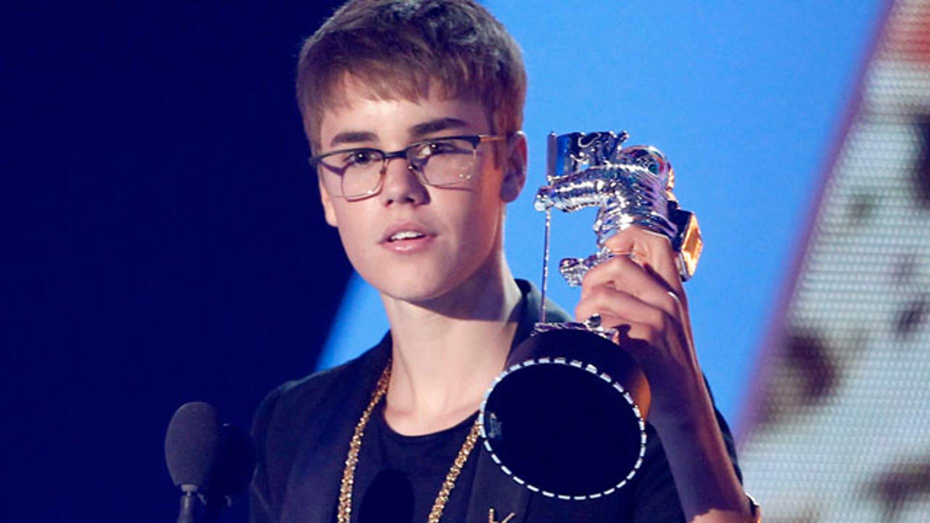 Justin Bieber accepts a VMA (AP)