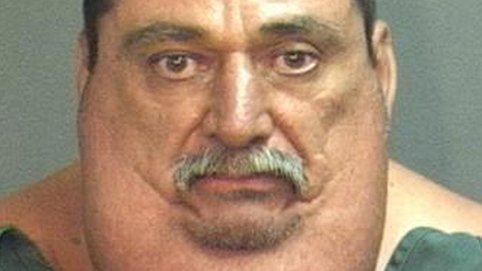 This photo provided by the Santa Ana Police Dept. shows 55-year-old Victor Joseph Espinoza.