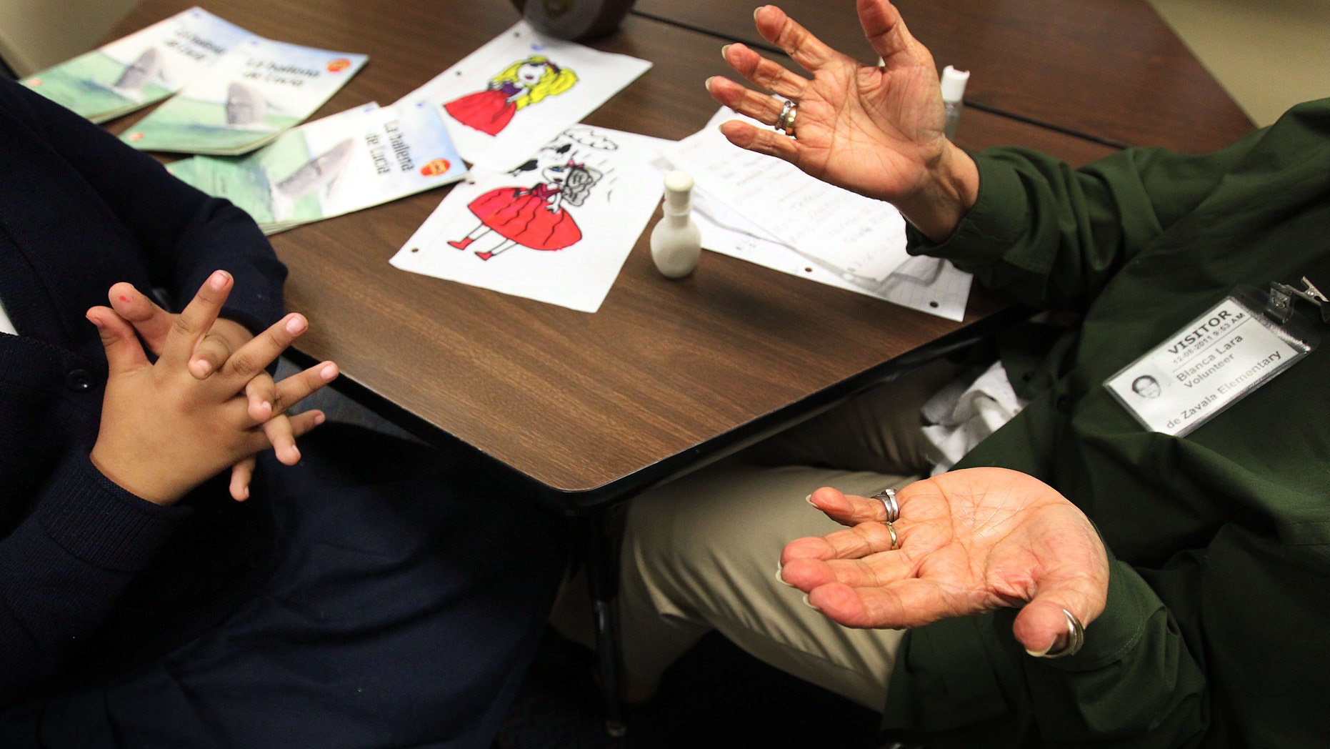 Blanca Lara, a senior volunteer, right, works with Teresa Rios, 8, left, during a tutoring session on Feb. 23, 2012 at Zavala Elementary School in Dallas, Texas. (AP Photo/The Dallas Morning News, Mona Reeder)