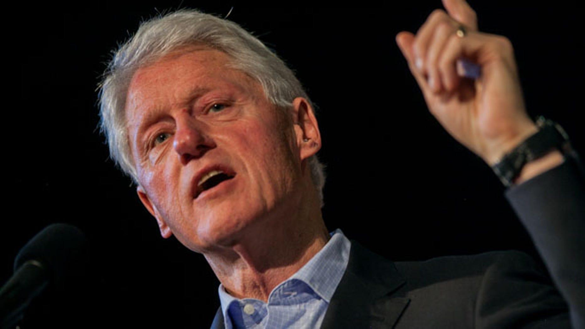 Former President Bill Clinton delivers a speech at Richmond Community High School in Richmond, Va. on Sunday, Oct. 27, 2013.
