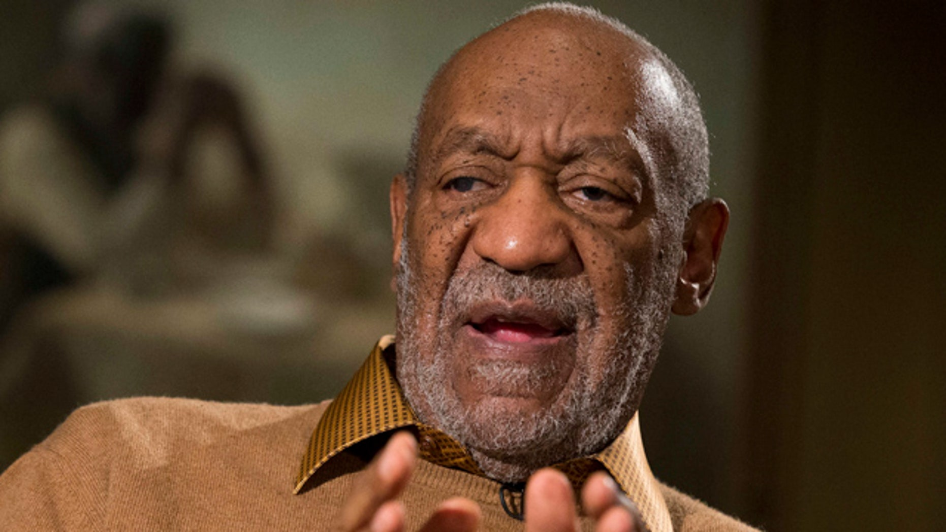 FILE - In this Nov. 6, 2014 file photo, entertainer Bill Cosby gestures during an interview about the upcoming exhibit, 'Conversations: African and African-American Artworks in Dialogue,' at the Smithsonian's National Museum of African Art, in Washington.  (AP Photo/Evan Vucci, File)
