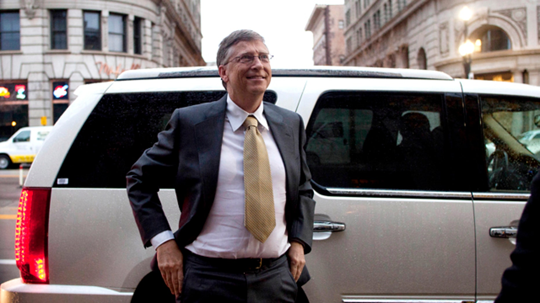 Nov. 21, 2011: Microsoft founder Bill Gates arrives at the Frank E. Moss federal courthouse in Salt Lake City to testify in a $1B antitrust lawsuit brought by Novell Inc. Gates, wearing a gray suit and a yellow tie, was the first witness as Microsoft lawyers presented their case in a trial that's been ongoing for about a month.
