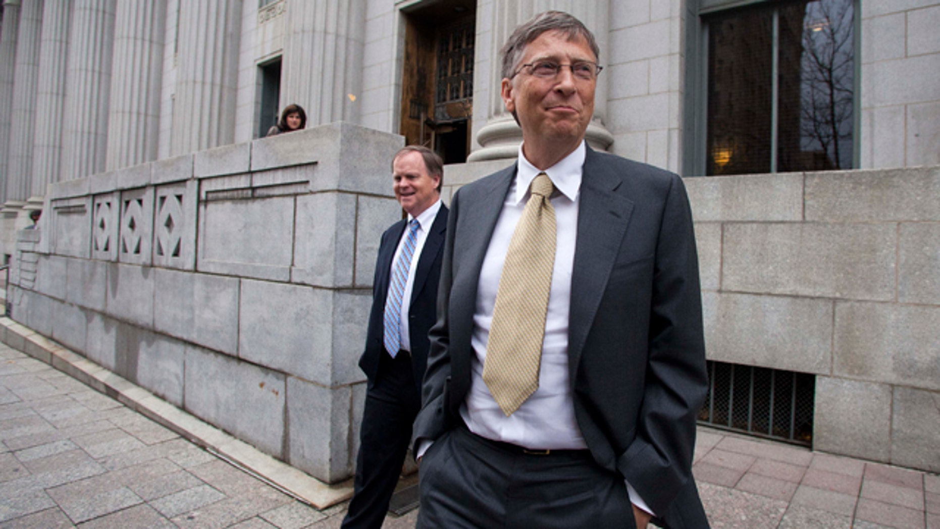 Nov.  21, 2011: Microsoft co-founder and chairman Bill Gates leaves the Frank E. Moss federal courthouse in Salt Lake City. Gates testified in a $1 billion antitrust lawsuit brought by Novell Inc.
