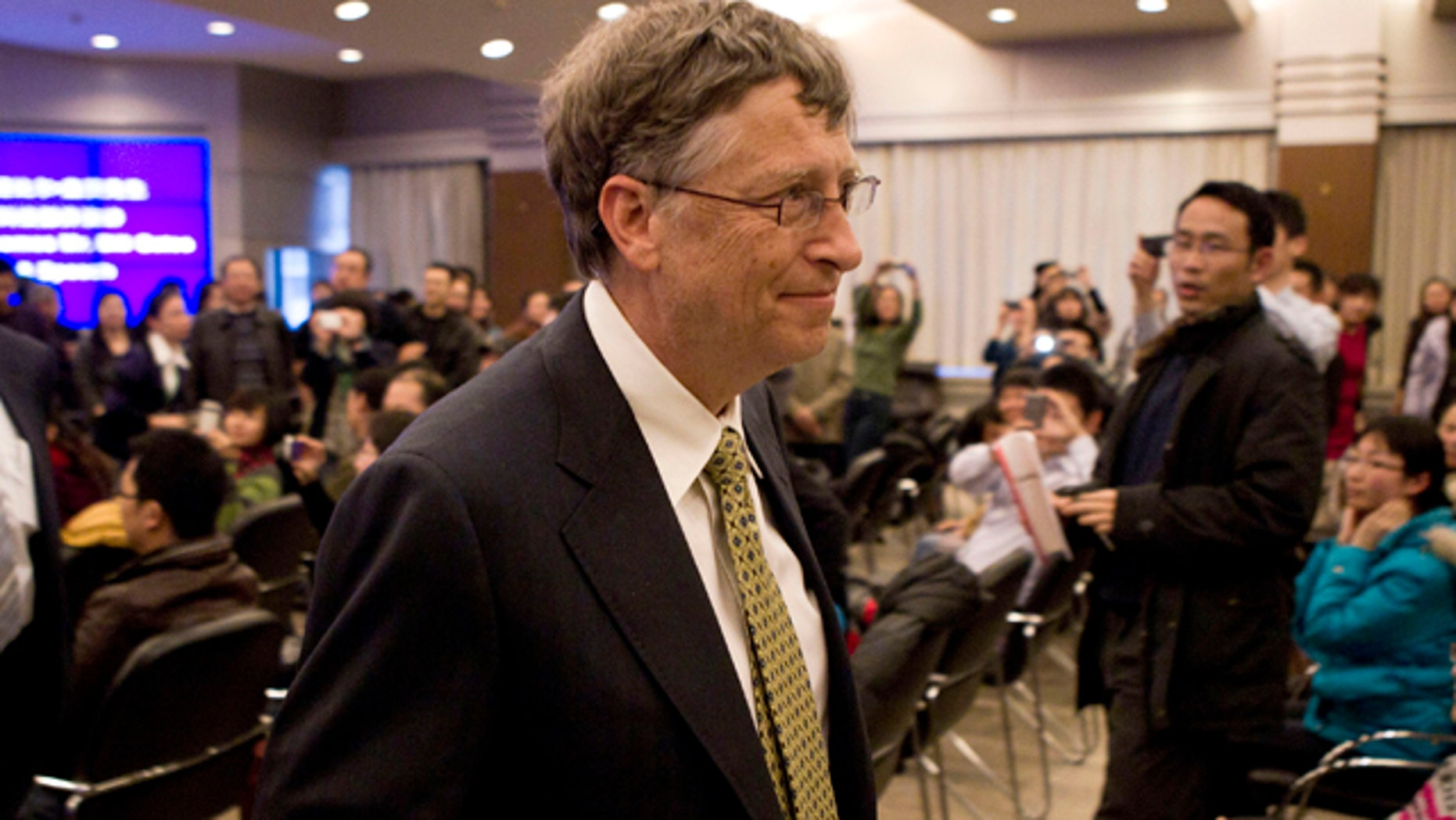 Dec. 7, 2011: Microsoft Corp. co-founder Bill Gates leaves after he delivered a speech at the Ministry of Science and Technology in Beijing. Gates confirmed Wednesday he is in discussions with China to jointly develop a new kind of nuclear reactor.