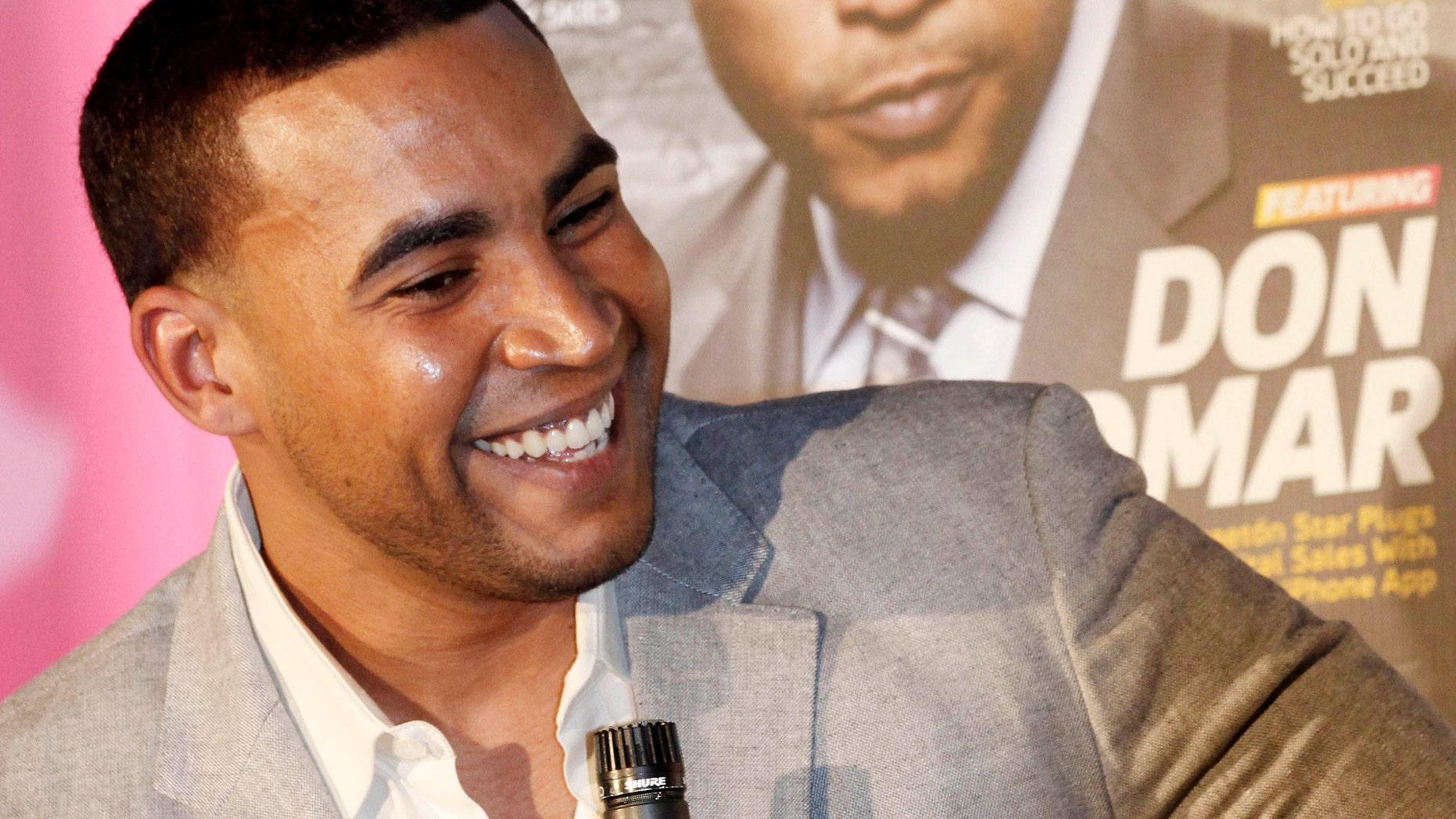 Puerto Rican reggaeton singer-rapper Don Omar smiles as he talks to a reporter in Miami on Tuesday. (AP Photo/Alan Diaz)