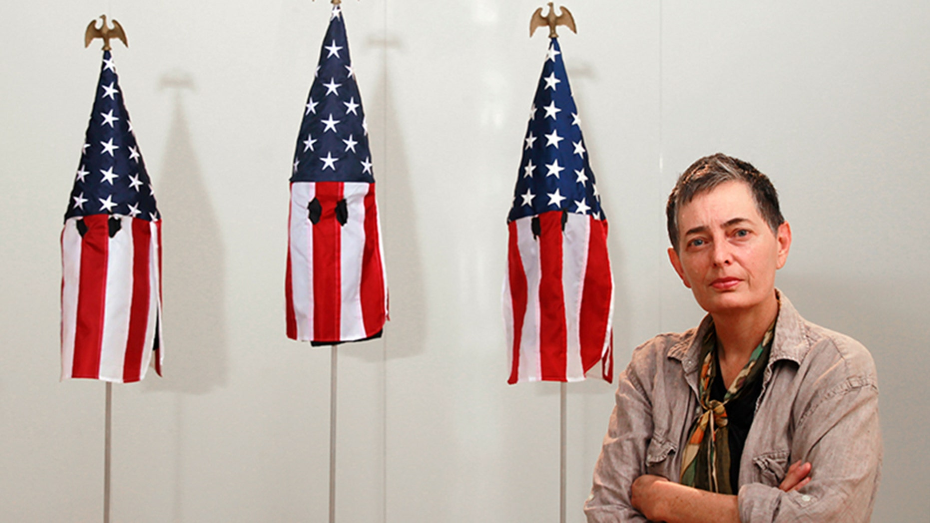University of Miami professor Billie Lynn sparked outrage for her art exhibit displaying American flags as Ku Klux Klan hoods.