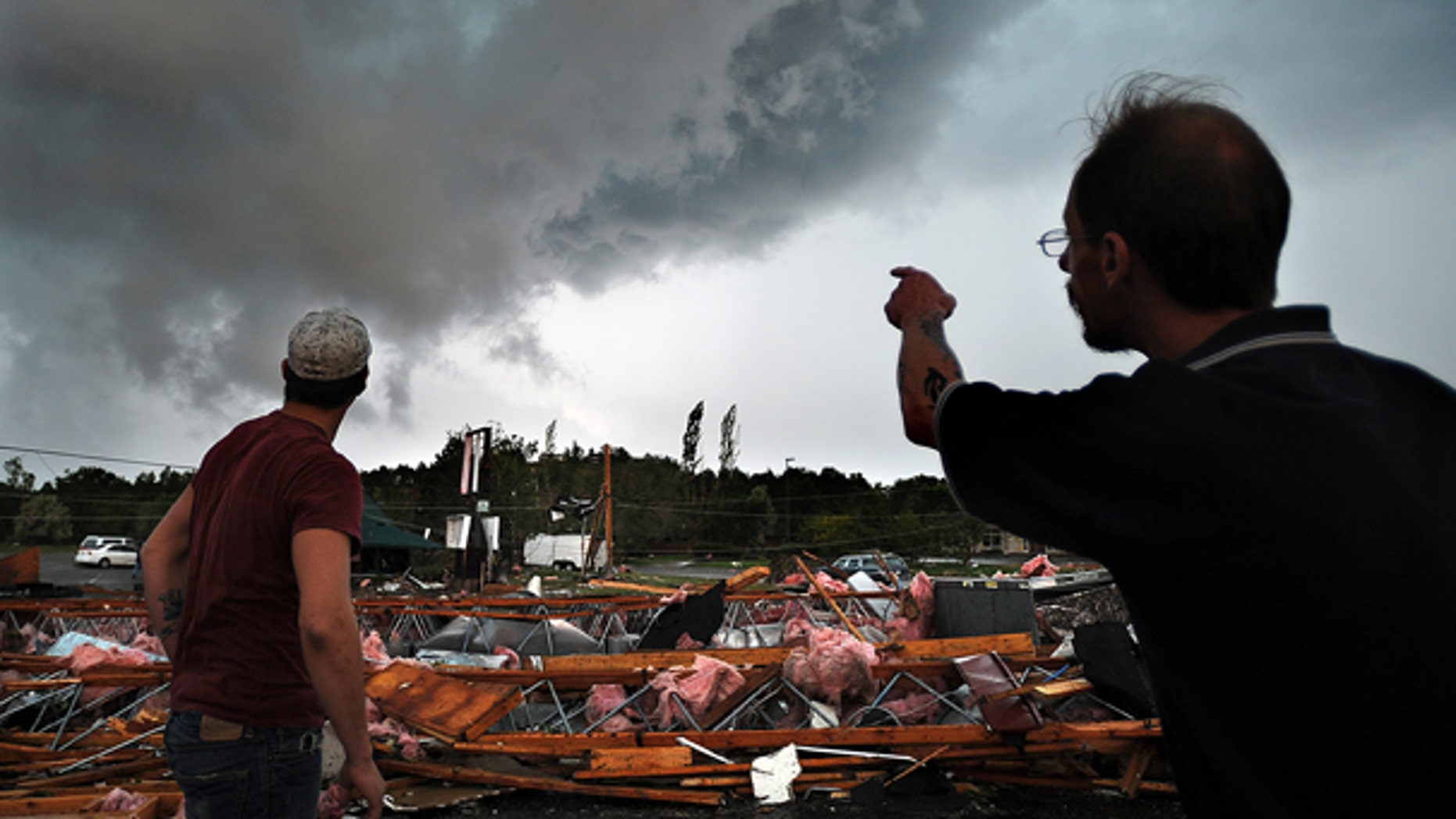 June 20: Main Street Casino staff members watch a second thunderstorm approach after they just survived a tornado in Billings, Mont. (AP)