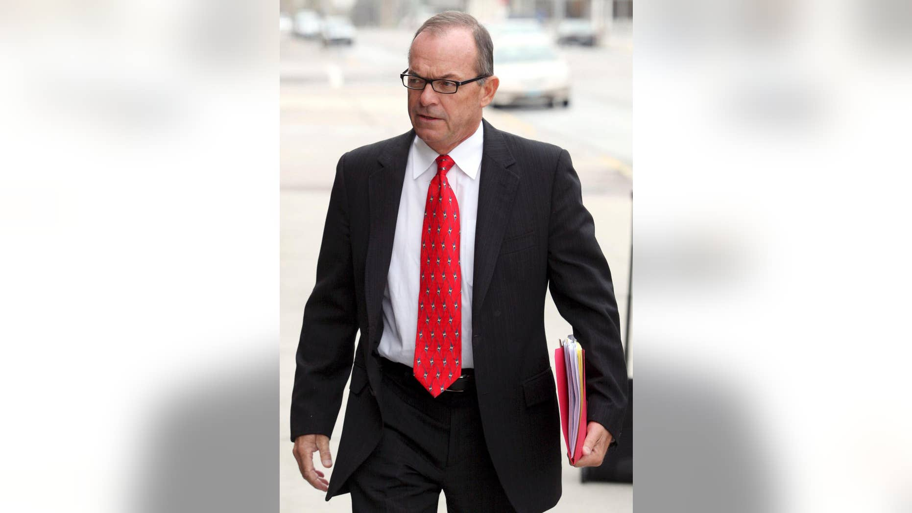 FILE - In this April 29, 2009, file photo, Tim Blixseth arrives at the federal courthouse in Missoula, Mont. The one-time billionaire is due in federal court in Butte, Mont., Thursday, Dec. 18, 2014, to explain why failed to comply with an order to pay $13.8 million to the creditors of an ultra-luxury Montana resort. (AP Photo/Mike Albans, File)