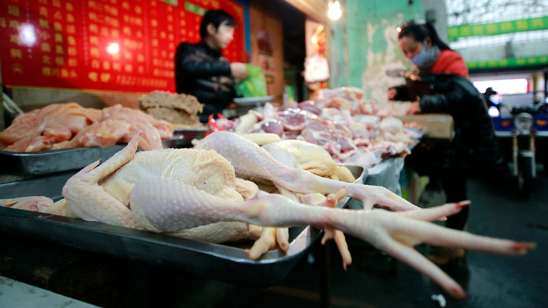 Chickens are sold at a market in Shanghai, China. In a worrisome sign, a bird flu in China appears to have mutated so that it can spread to other animals, raising the potential for a bigger threat to people, scientists said Wednesday.