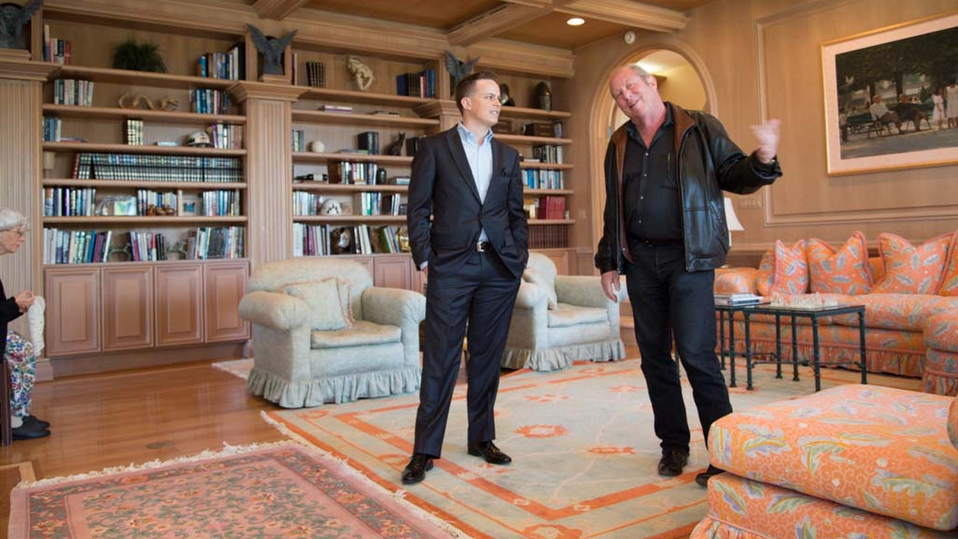 Dec. 12, 2013: In this photo, Jack Sommer, right, and his real estate agent Craig Tann stand in the library of Sommers'; home in the Spanish Trail neighborhood of Las Vegas.