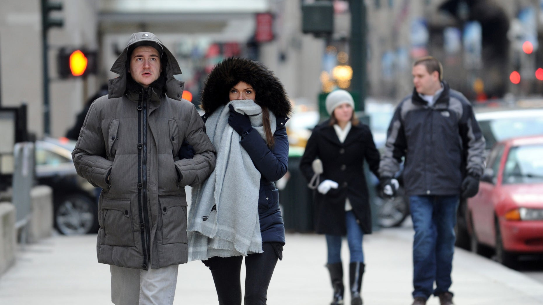 "Benedikt Vom Orde and Julia Felte, tourists from Essen, Germany, walk along Park Avenue in New York during a bitter cold spell, Saturday, Feb. 13, 2016. Bitter temperatures and biting winds had much of the northeastern United States bundling up for the some of the worst cold of the winter â a snap so bad it forced an ice festival in Central Park to cancel and caused an Interstate pileup that killed three. ""These temperatures can be life threatening â especially for seniors, infants and people with medical conditions,"" New York City Mayor Bill de Blasio said. Stay indoors and take care of each other, he counseled. (AP Photo/Diane Bondareff)"