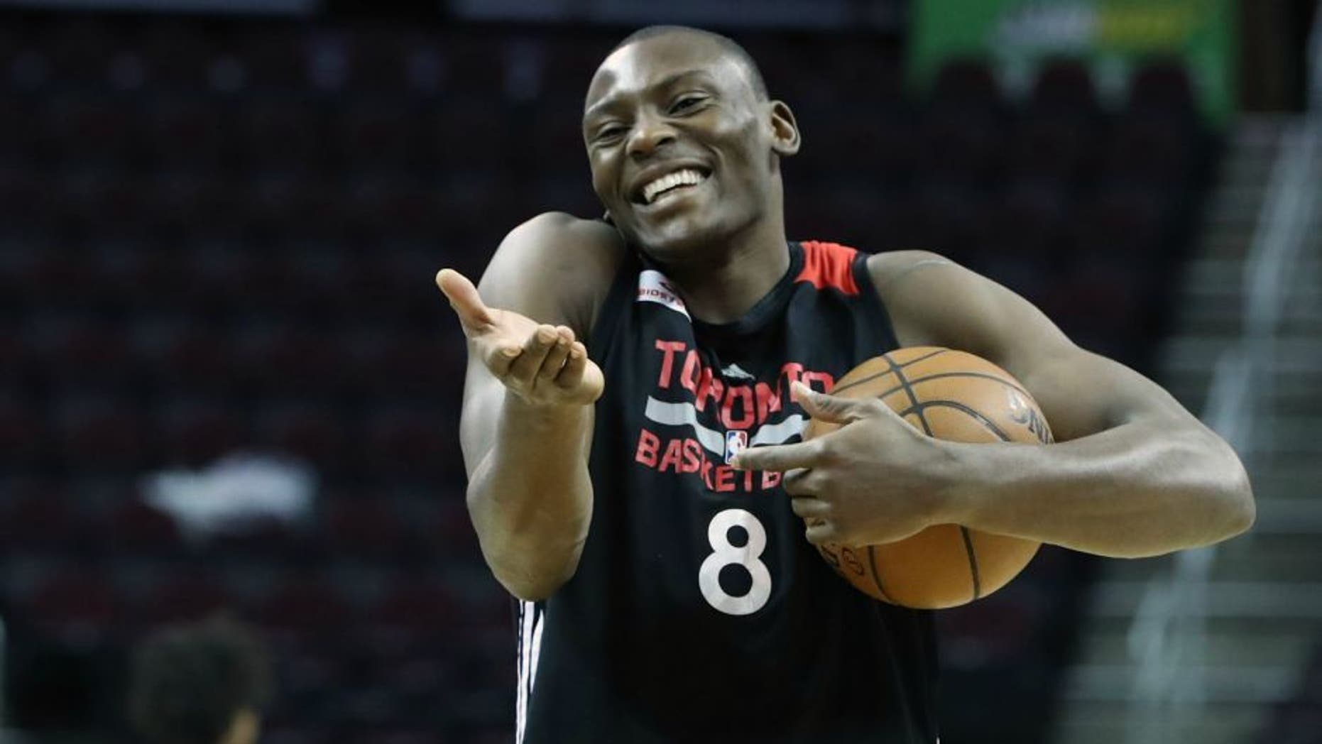 CLEVELAND, OH- MAY 25: Bismack Biyombo laughs after experimenting with an underhanded throw as the Toronto Raptors prepare to play the Cleveland Cavaliers in game 5 of the NBA Conference Finals at Quicken Loans Arena in Cleveland. May 25, 2016. (Steve Russell/Toronto Star via Getty Images)