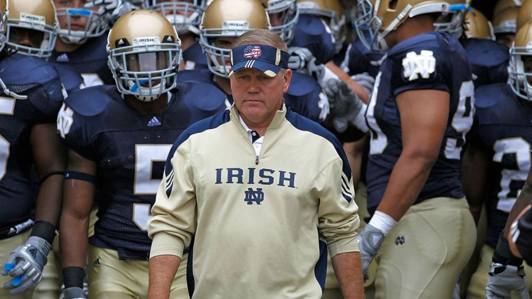 SOUTH BEND, IN - SEPTEMBER 11: Head coach Brian Kelly of the Notre Dame Fighting Irish waits to enter the field with his team before a game against the Michigan Wolverines at Notre Dame Stadium on September 11, 2010 in South Bend, Indiana. Michigan defeated Notre Dame 28-24. (Photo by Jonathan Daniel/Getty Images) *** Local Caption *** Brian Kelly