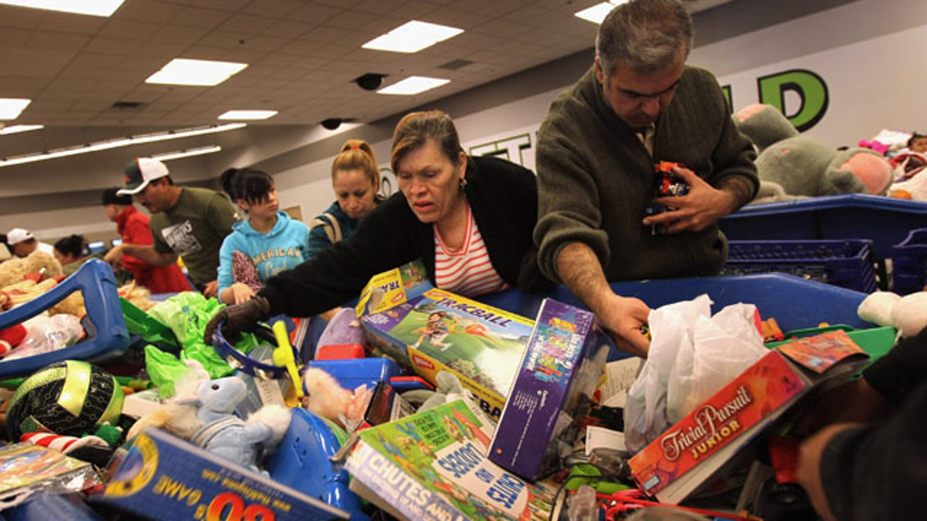DENVER - NOVEMBER 26:  Low-income shoppers search bins for toys at a Goodwill thrift store on Black Friday, November 26, 2010 in Denver, Colorado. People packed the thrift store on the busiest shopping day of the year, buying toys and clothes in bulk for as cheap as 59 cents a pound.  (Photo by John Moore/Getty Images)