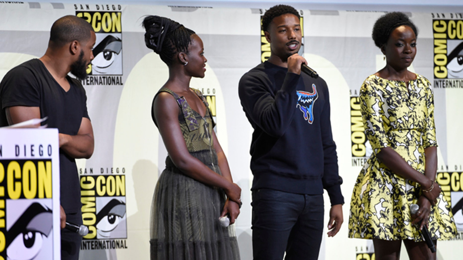 """FILE - In this July 23, 2016 file photo, director Ryan Coogler, from left, Lupita Nyong'o, Michael B. Jordan and Danai Gurira attend the """"Black Panther"""" panel on day 3 of Comic-Con International in San Diego. The movie set to begin filming in January will mark the third time director Ryan Coogler has worked with actor Michael B. Jordan. They teamed up previously on """"Creed"""" and """"Fruitvale Station.""""  (Photo by Chris Pizzello/Invision/AP, File)"""