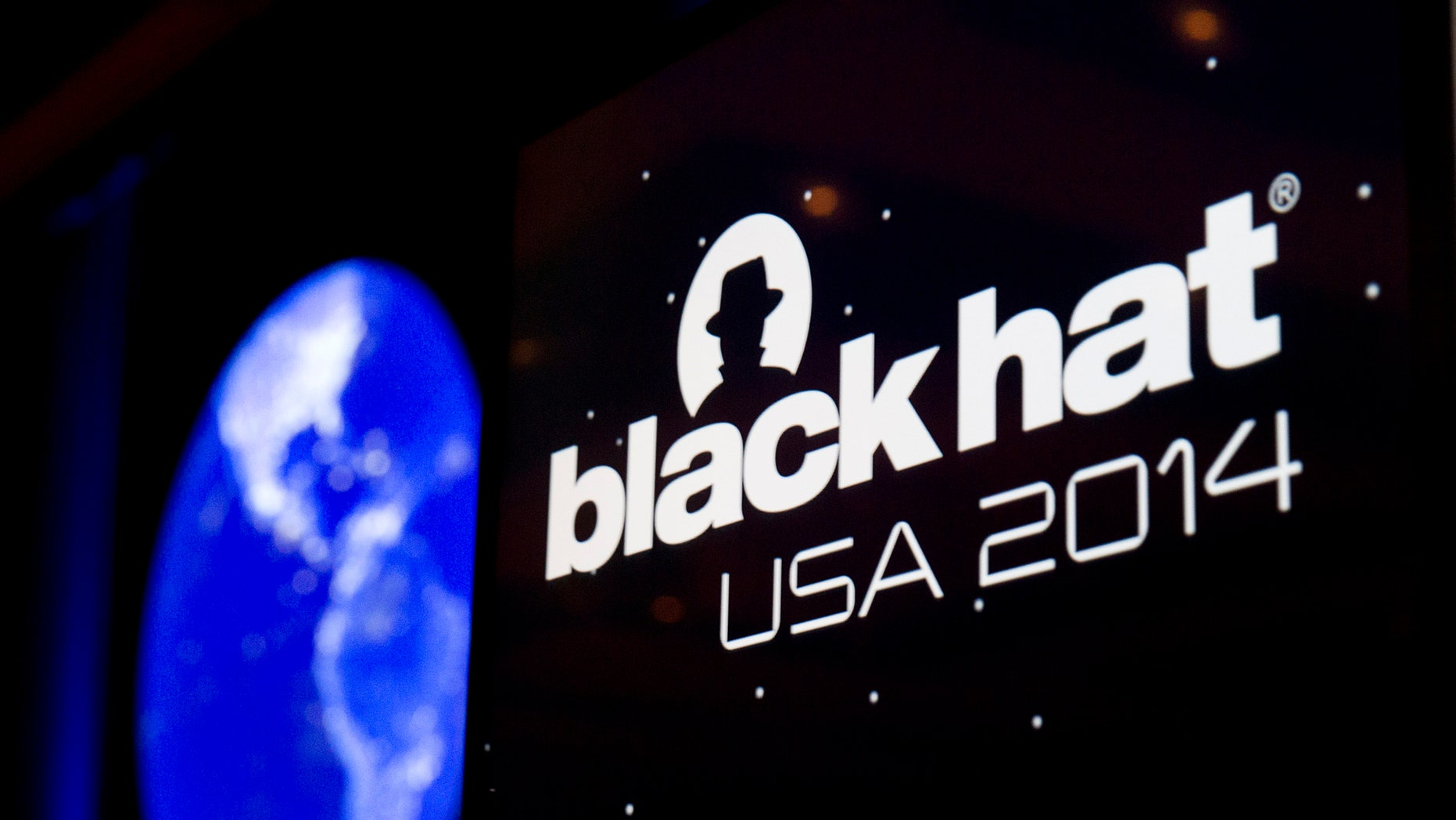 The Black Hat logo is shown on a podium during the Black Hat USA 2014 hacker conference at the Mandalay Bay Convention Center in Las Vegas, Nevada August 6, 2014. REUTERS/Steve Marcus (UNITED STATES - Tags: SCIENCE TECHNOLOGY) - RTR41H30