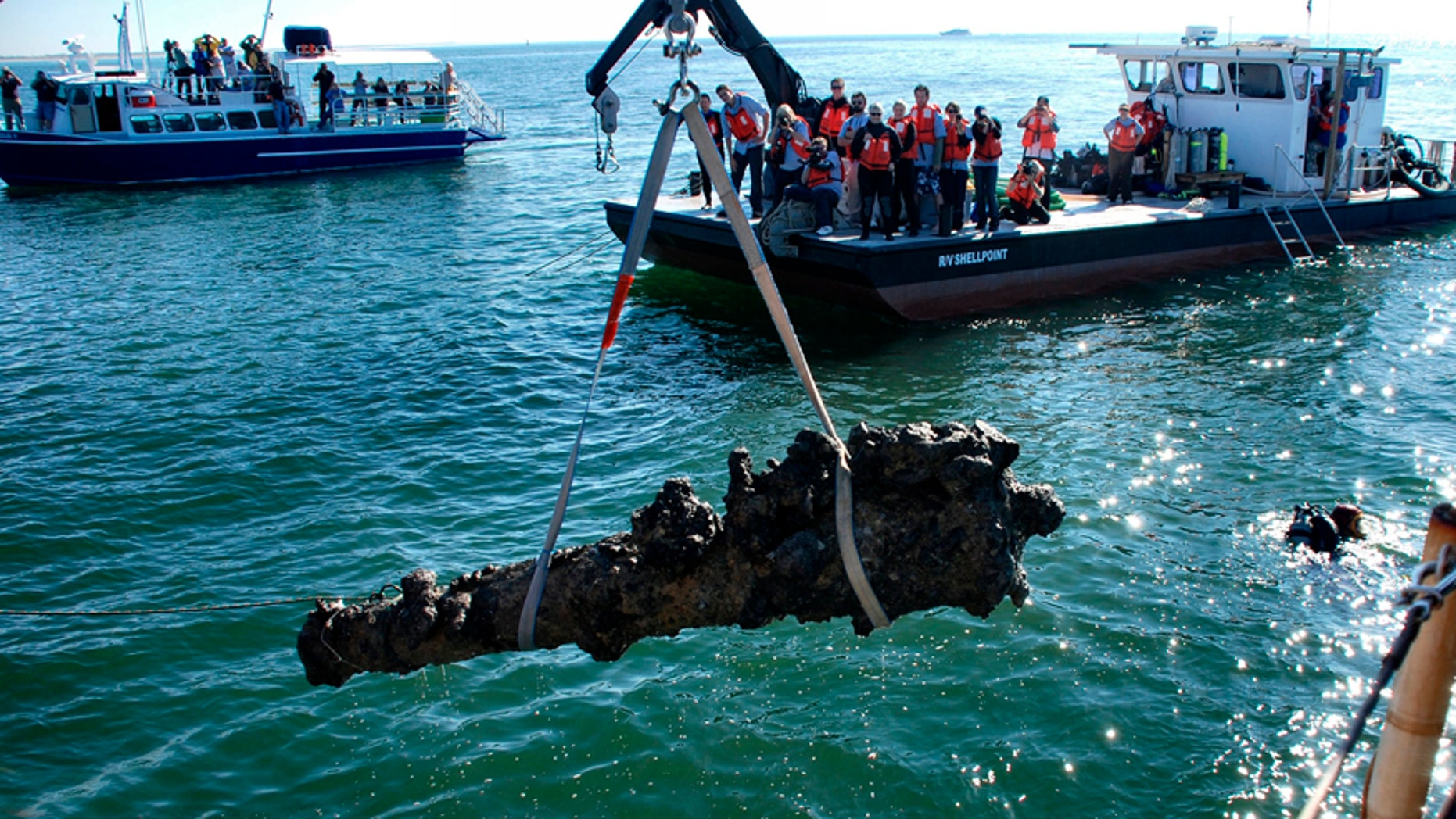 File photo - A one-ton cannon which was recovered from the Queen Anne's Revenge shipwreck site, is pulled from the water near Beaufort, North Carolina, Oct. 26, 2011.