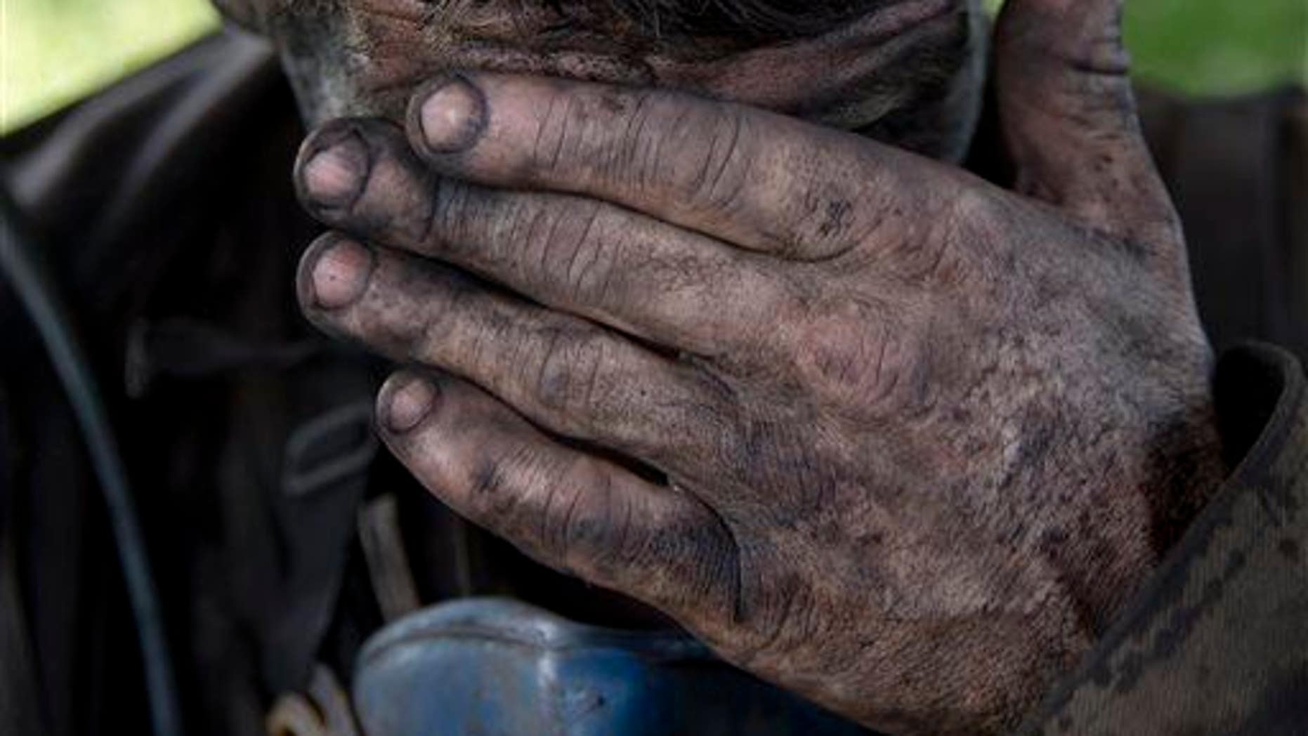 In this picture taken on May 20, 2014, a Ukrainian miner wipes his face after finishing his shift at a coal mine in Donetsk, Ukraine.