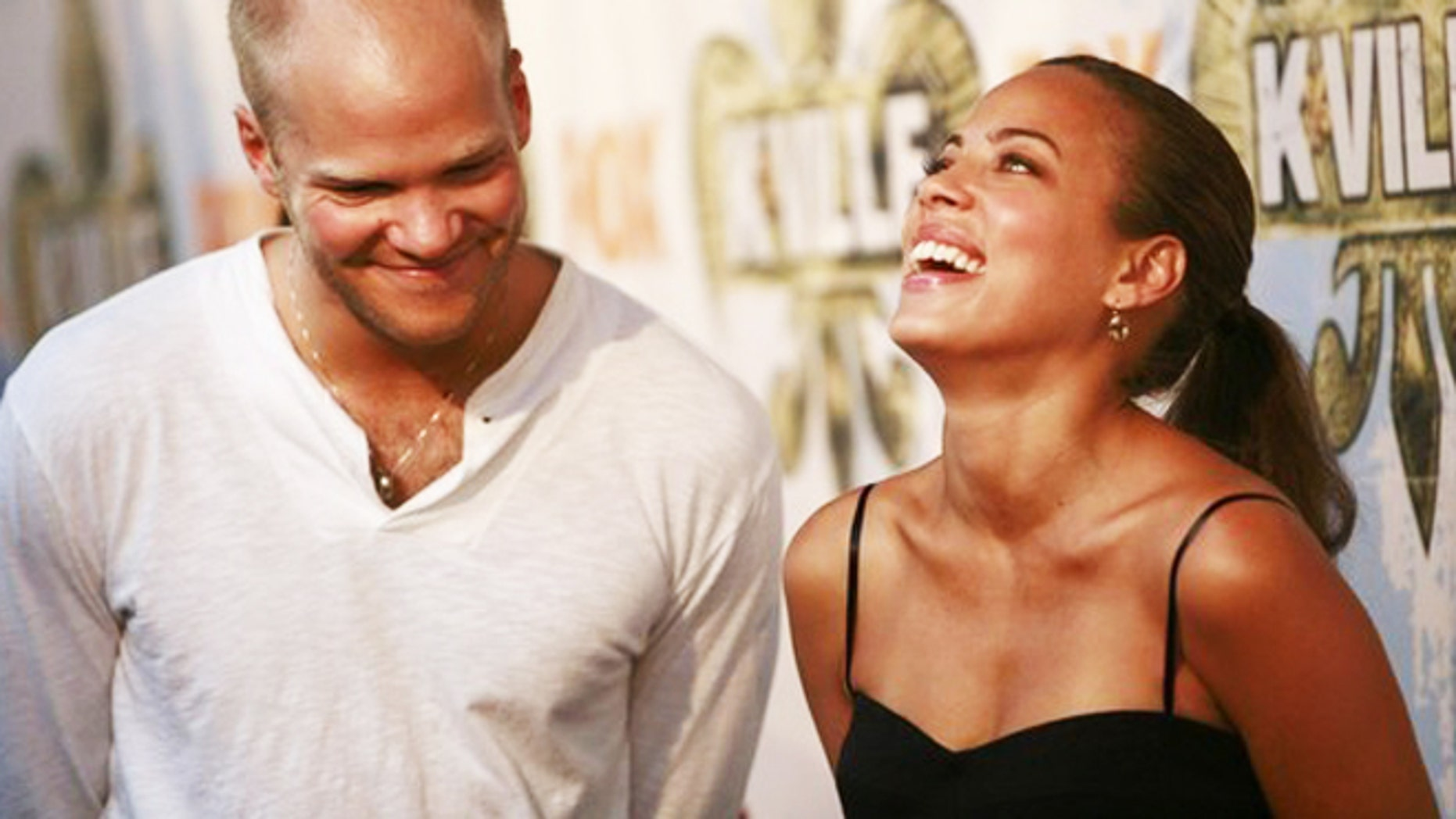"""Cast members Blake Shields (L) and Tawny Cypress laugh before a party celebrating the television series """"K-Ville"""" in New Orleans, Lousiana August 19, 2007."""