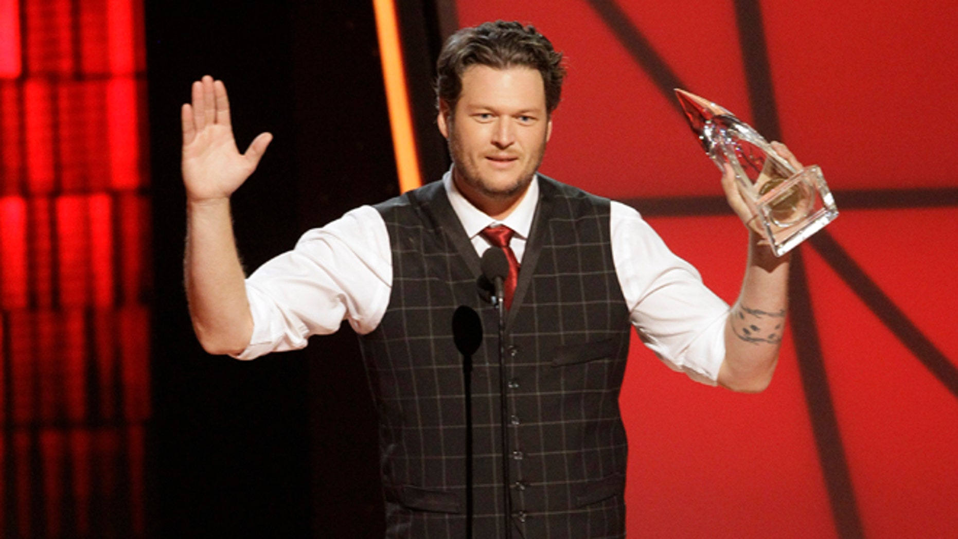 Nov. 1, 2012: Blake Shelton accepts the award for entertainer of the year at the 46th Annual Country Music Awards at the Bridgestone Arena in Nashville, Tenn.