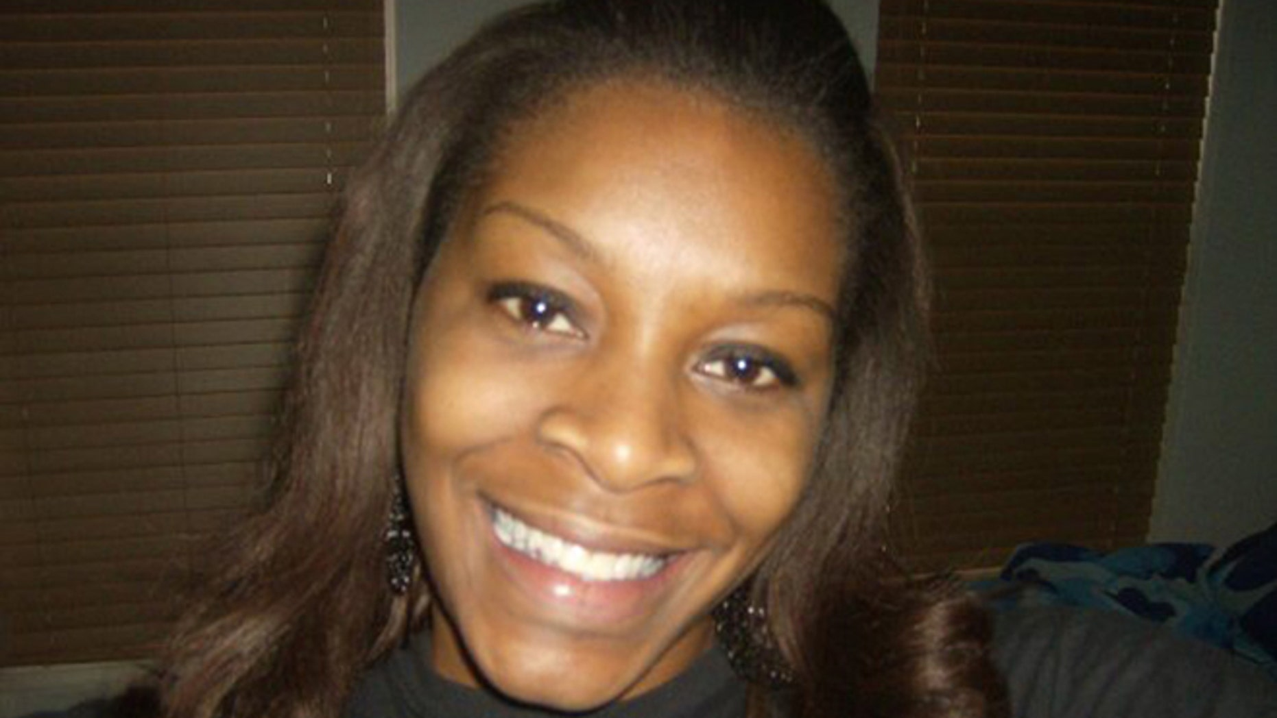FILE - In this undated photo provided by the Bland family, Sandra Bland poses for a photo. A grand jury indicted Trooper Brian Encinia on Wednesday, Jan. 6, 2016, with the misdemeanor charge. Encinia has been on desk duty since Bland was found dead in her cell in July. Her death was ruled a suicide. (Courtesy of Bland family via AP, File)