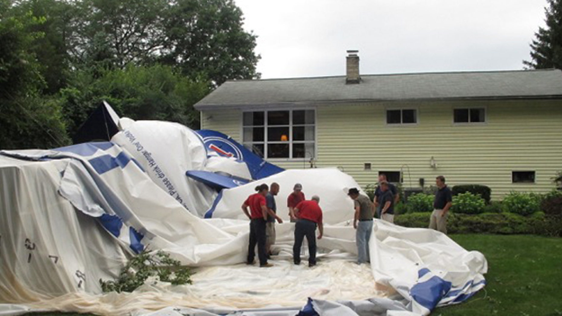 Aug. 14: Crews take apart a blimp that broke free and landed in a backyard.