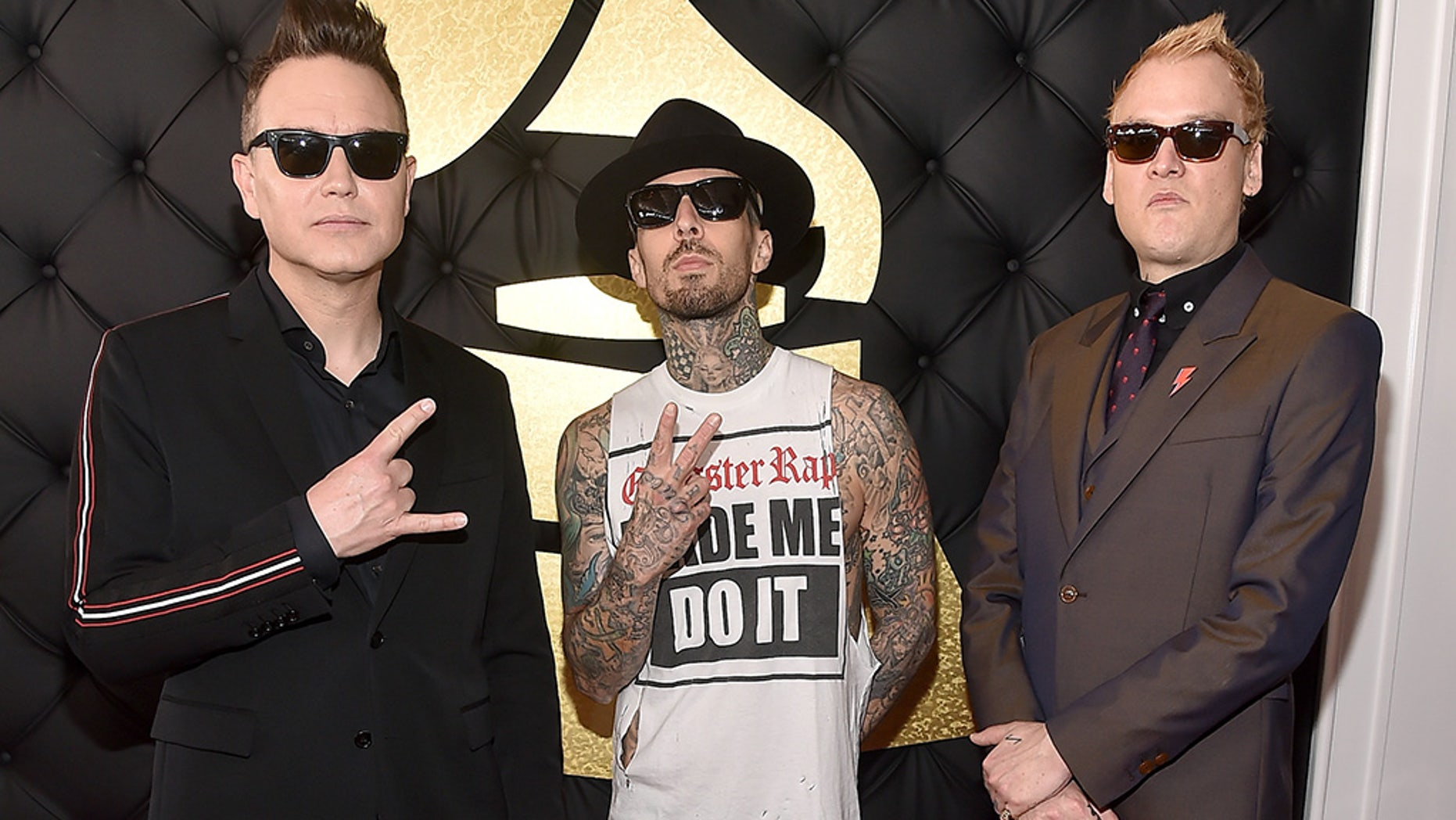 Blink-182 announced it would have to postpone this weekend's shows after Travis Barker [middle] suffered from blood clots in both of his arms.