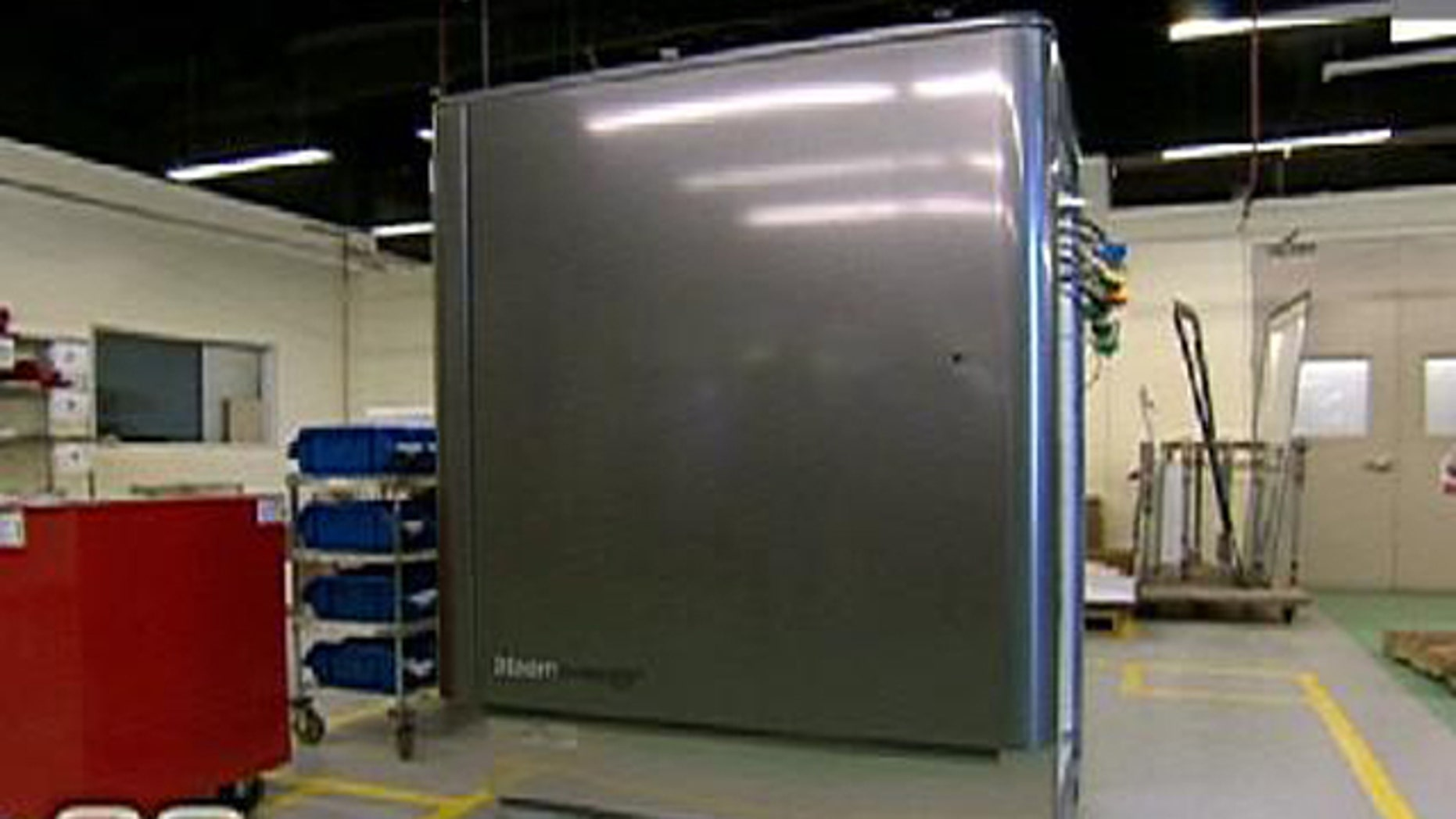 A screenshot from 60 Minutes showing the Bloom Box, a fridge-sized fuel cell designed to make electricity through chemistry.