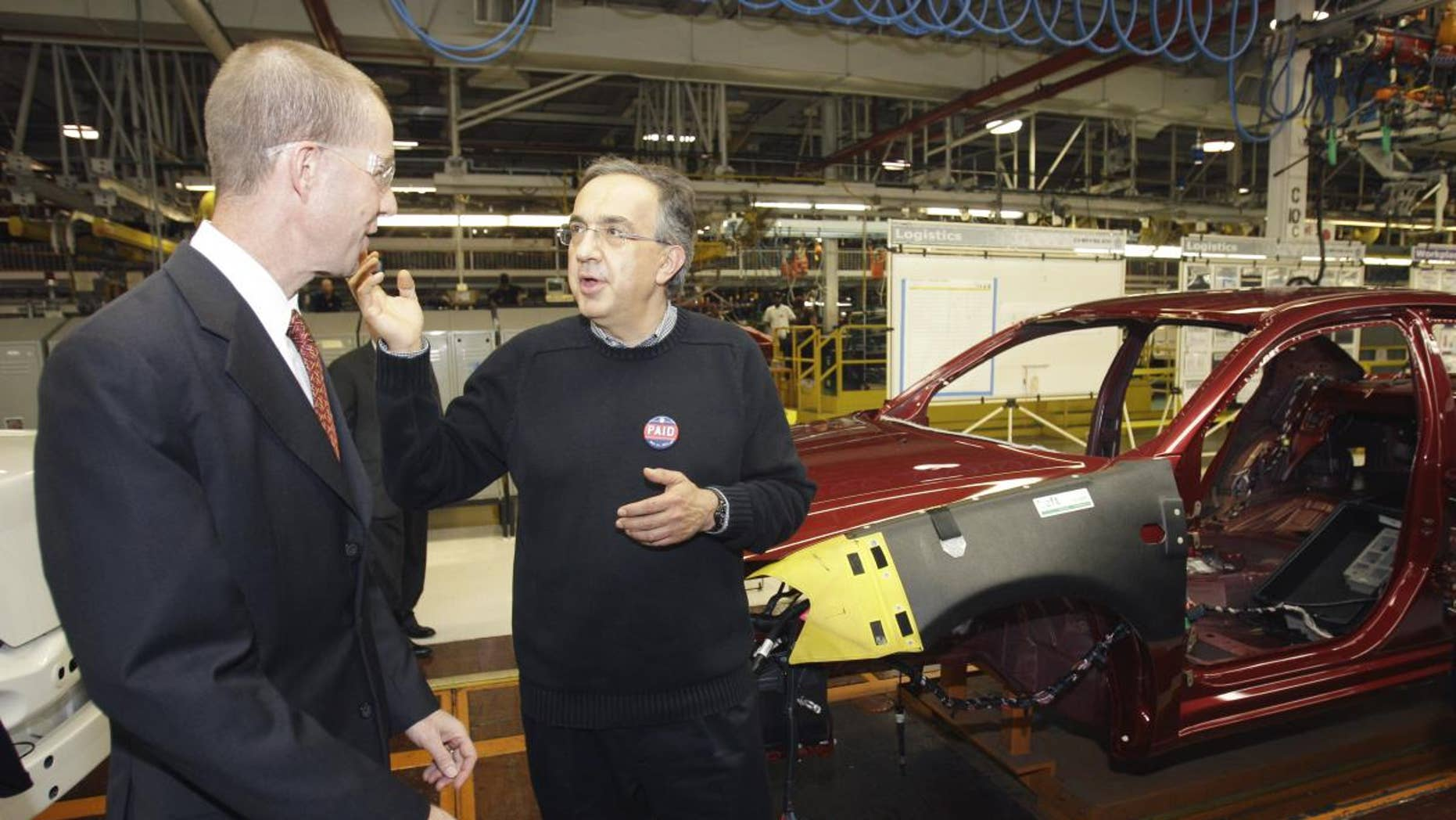 Chrysler Group CEO Sergio Marchionne, right, and Ron Bloom, assistant to President Obama for Manufacturing Policy walk on the assembly line at the Sterling Heights Assembly Plant in Sterling Heights, Mich., Tuesday, May 24, 2011. Marchionne acknowledged and expressed gratitude for the financial support from the U.S. and Canadian governments. (AP Photo/Carlos Osorio)
