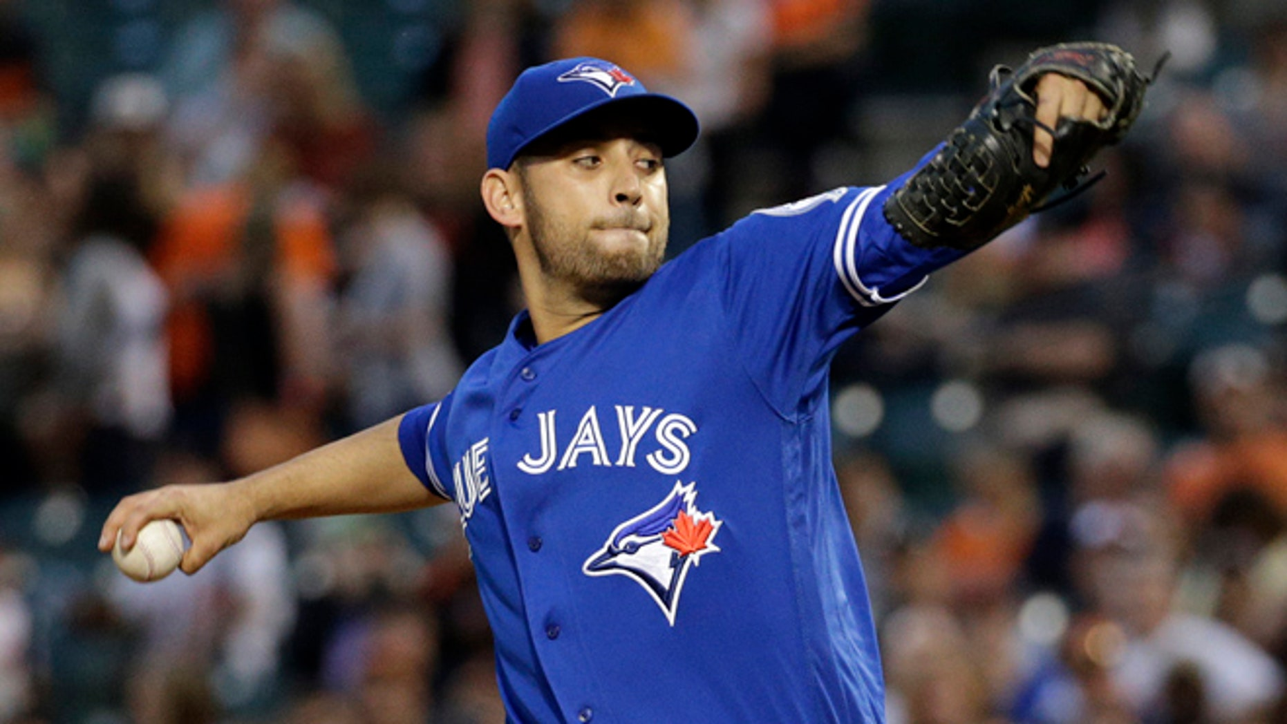 "FILE- In this April 21, 2016, file photo, Toronto Blue Jays starting pitcher Marco Estrada throws to the Baltimore Orioles during the first inning of a baseball game in Baltimore. Estrada has gone on the disabled list because of a sore lower back and will not play in the All-Star Game. ""My worst nightmare came true, unfortunately,"" Estrada said Wednesday, July 6. ""In the long run, this is the right thing to do."" (AP Photo/Patrick Semansky, File)"